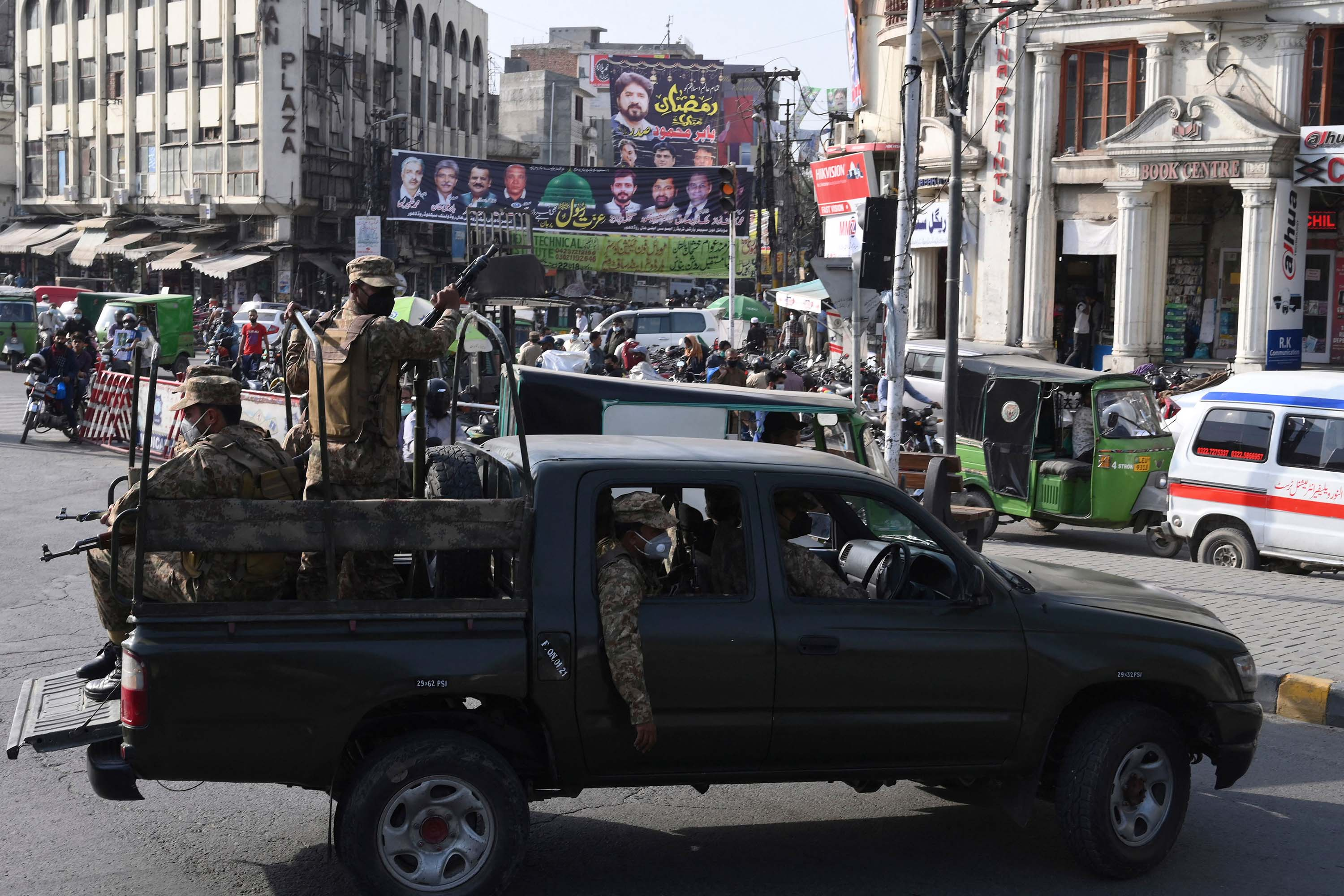 Army soldiers patrol a street in Lahore, Pakistan, on April 26, to enforce new coronavirus restrictions.