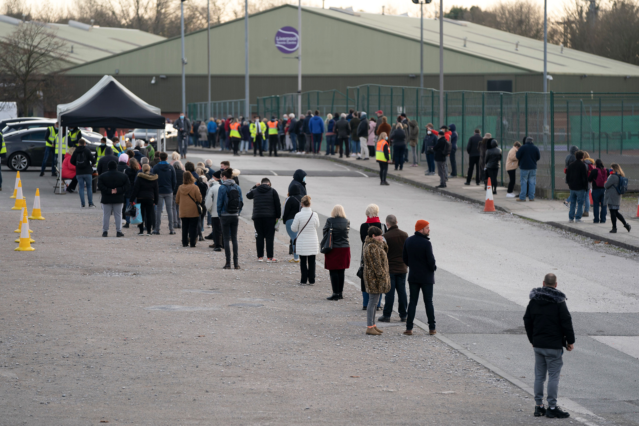 People wait in line at a Covid-19 testing center in Liverpool, England, on November 6, 2020.