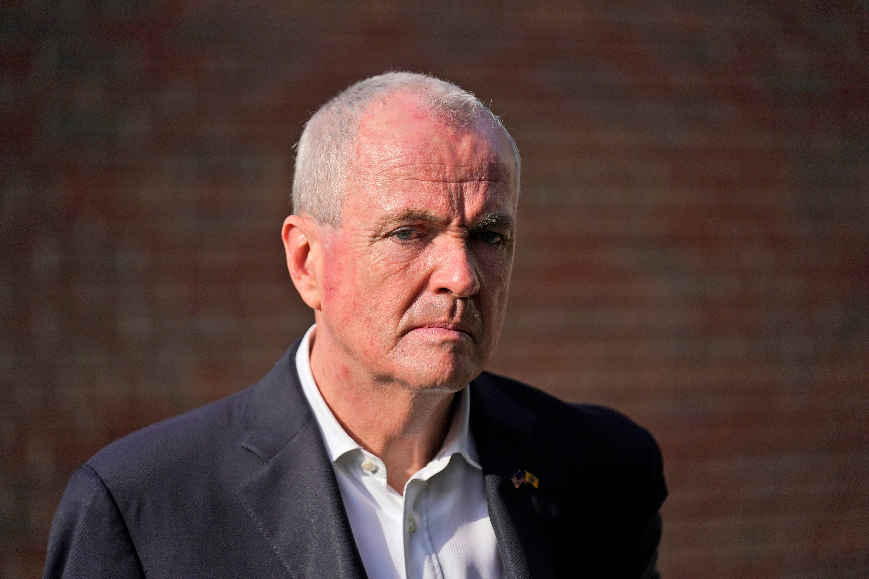 New Jersey Gov. Phil Murphy talks to reporters on June 8.