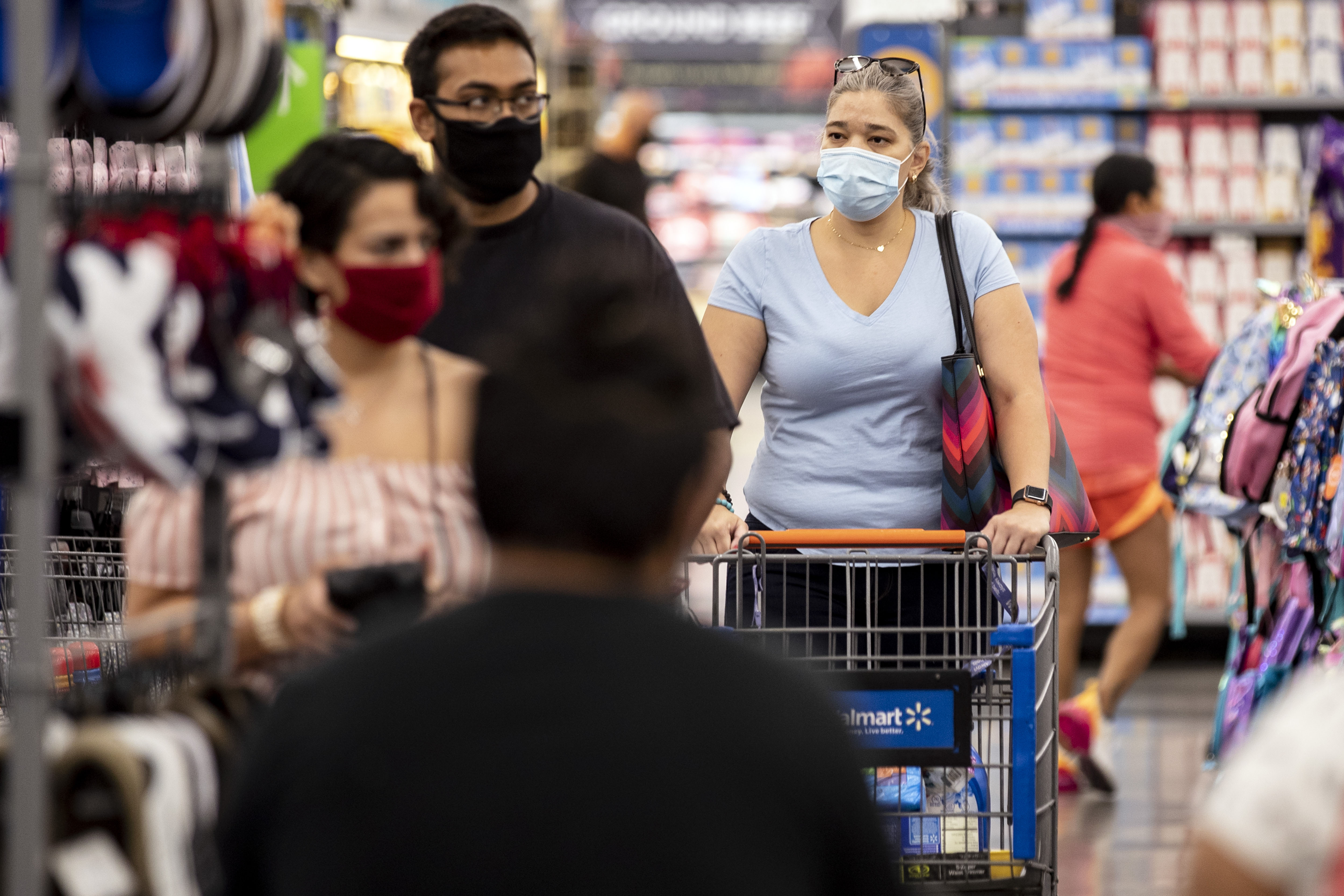 People shop at a Walmart in Burbank, California, on July 15.