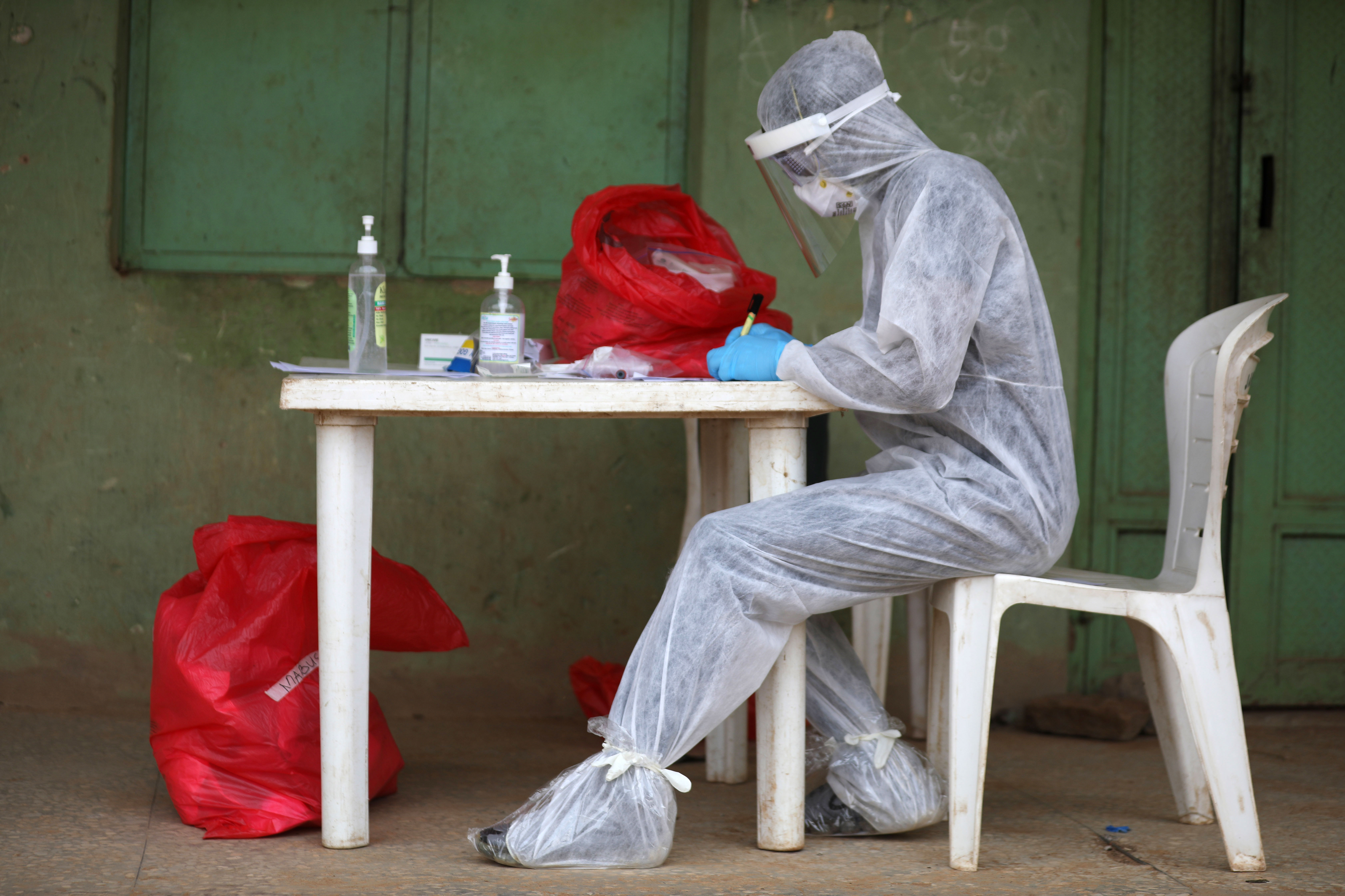 A health care professional in Abuja, Nigeria, works on a sample during a community Covid-19 testing campaign on April 15.