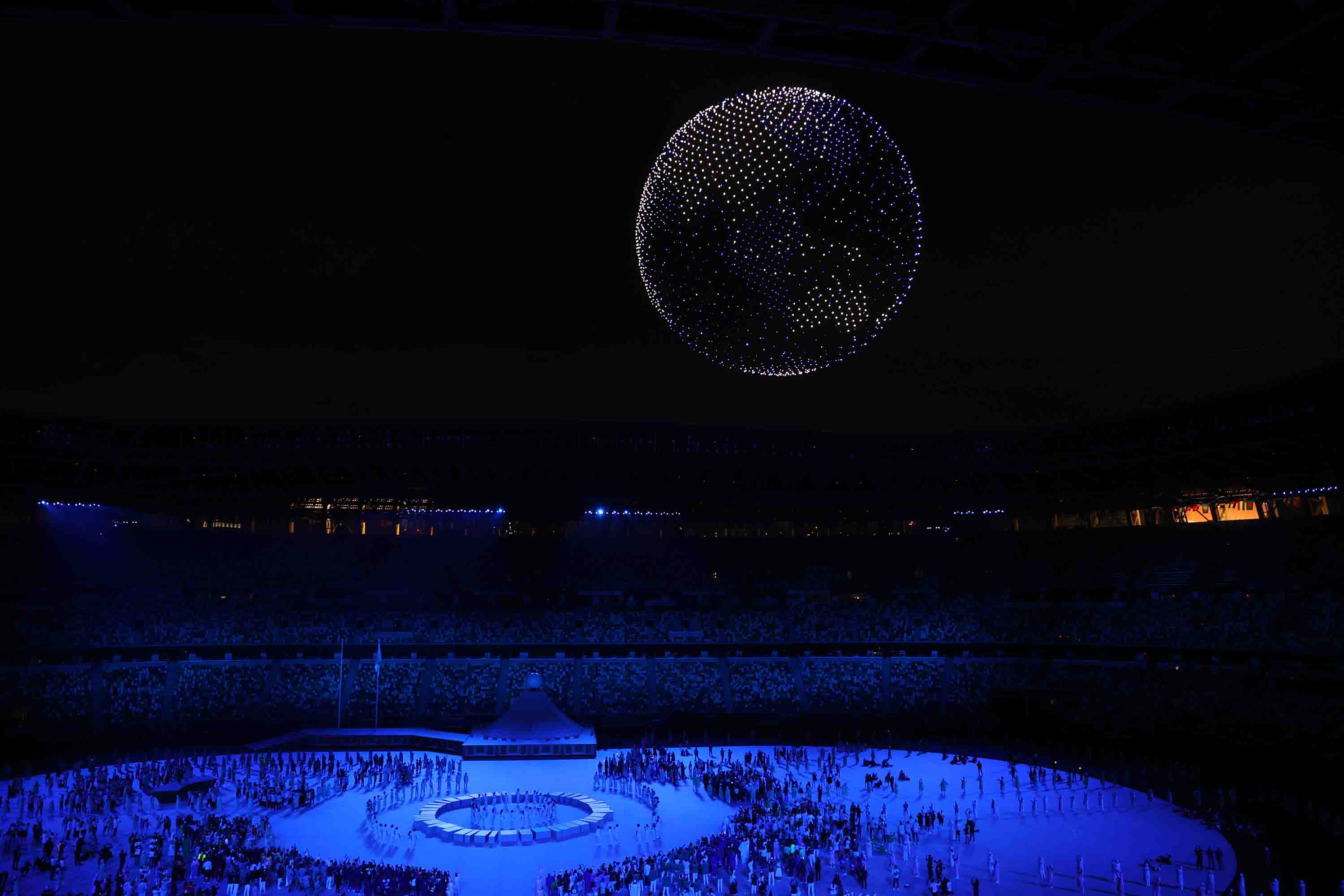 Drones fly over the stadium in the form of a globe during the Opening Ceremony.