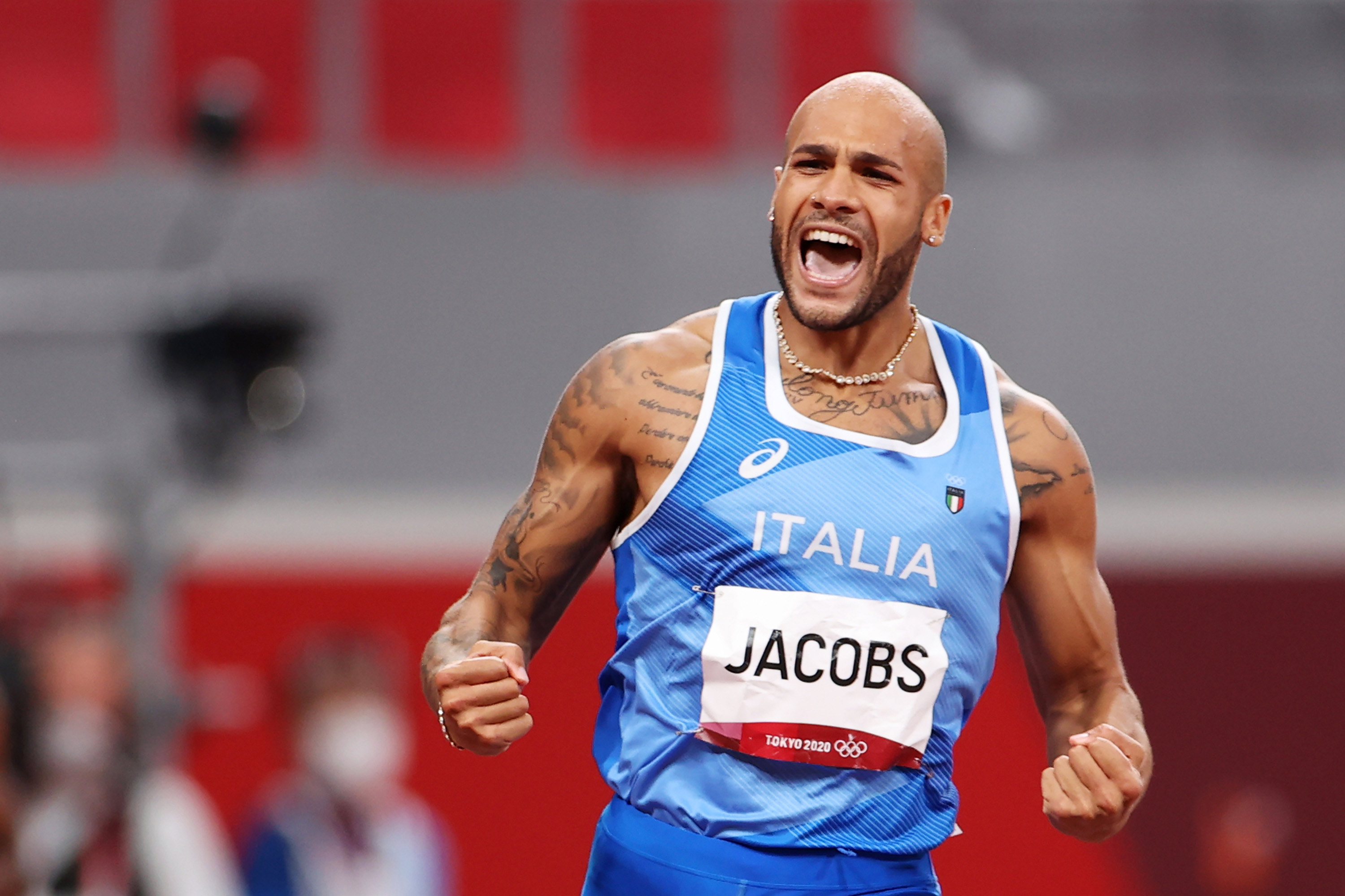 Lamont Marcell Jacobs celebrates becoming the first Italian man to ever win the men's Olympic 100m gold medal.