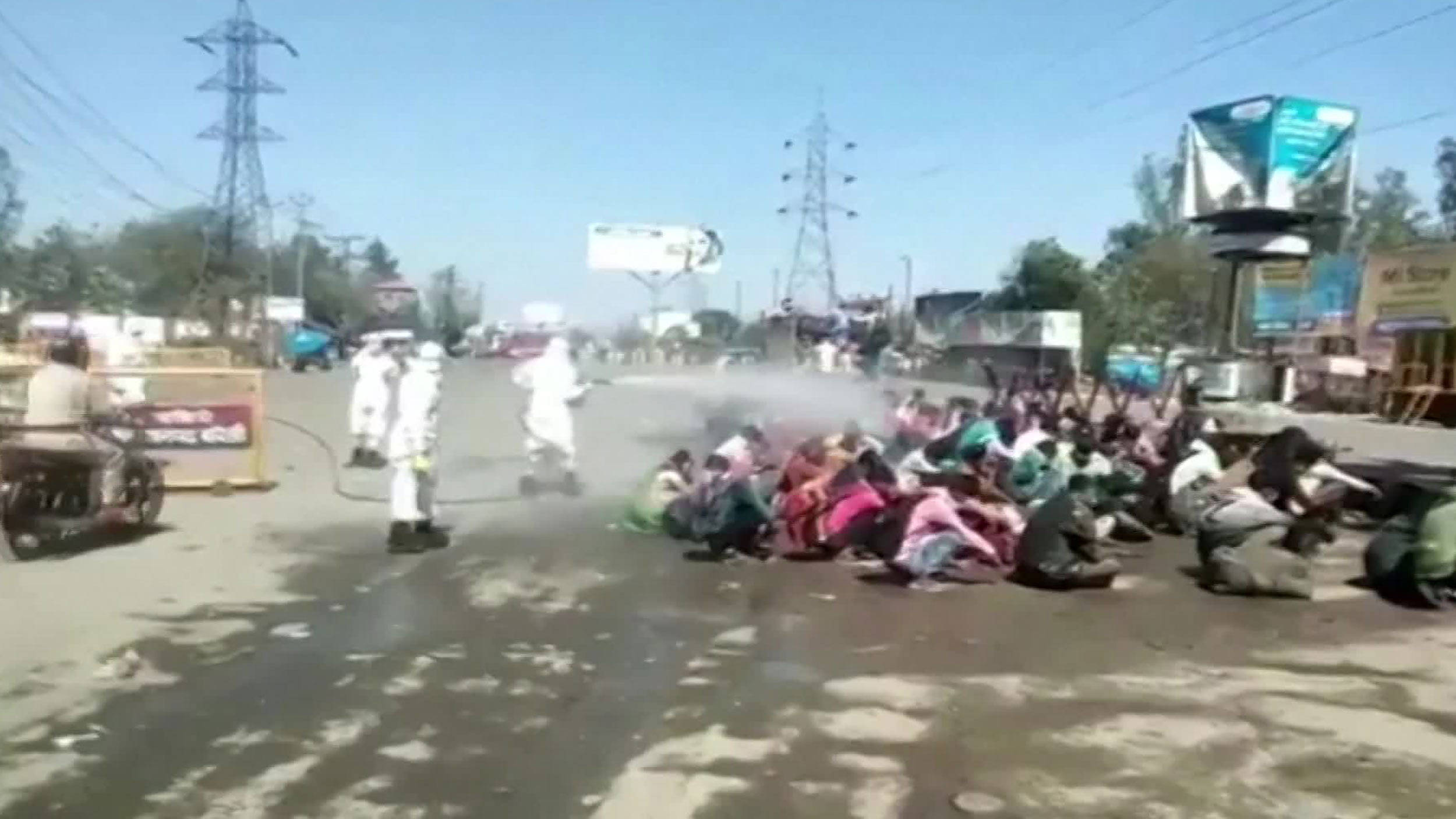 Workers are sprayed with disinfectant in Uttar Pradesh, India.