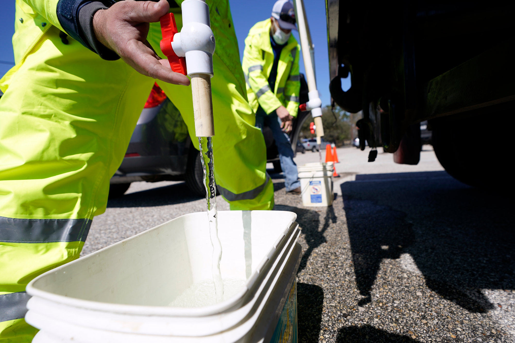 Containers are filled with non-potable water at a water distribution site on February 19 in Houston, Texas.