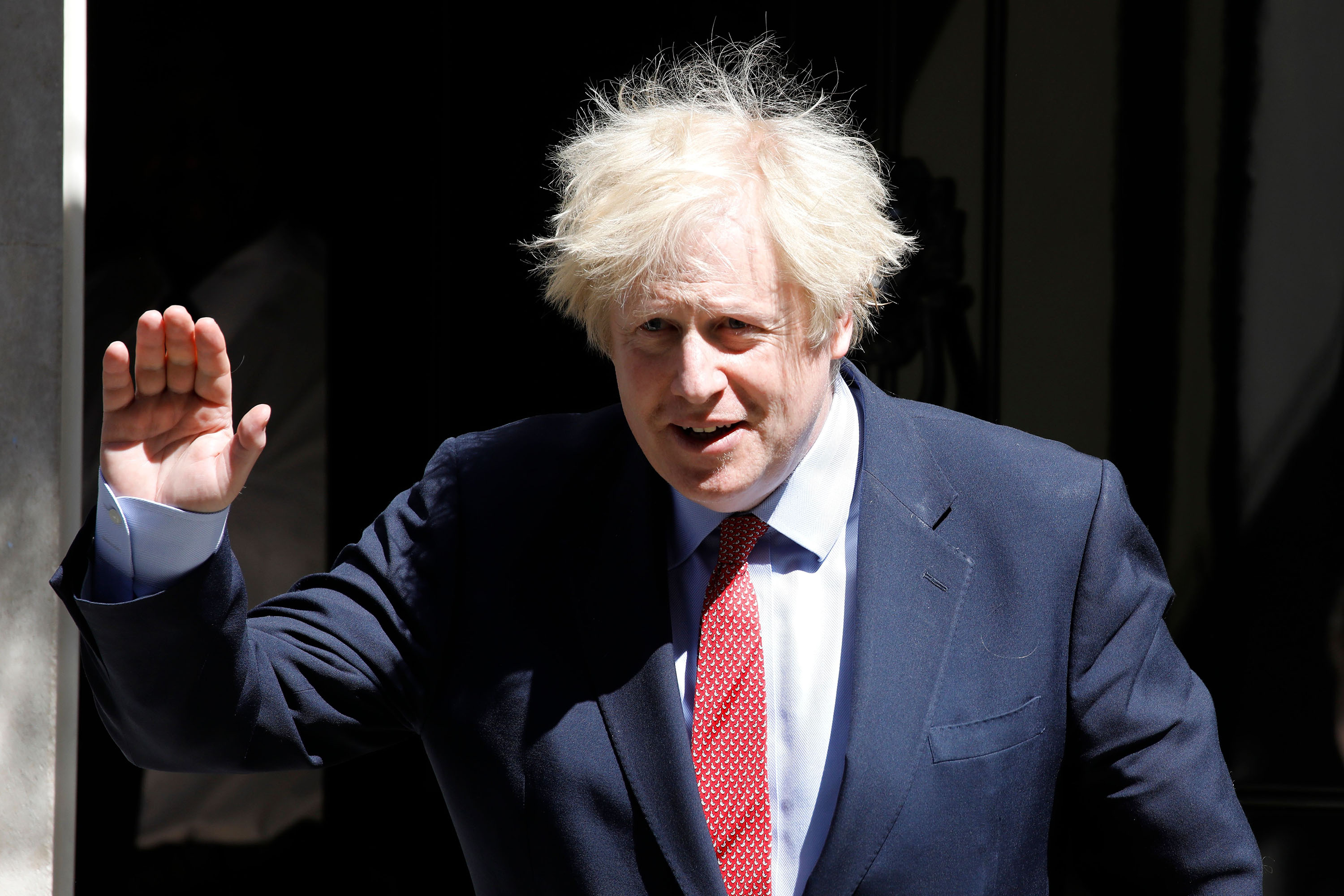 Britain's Prime Minister Boris Johnson leaves 10 Downing Street in London, on Wednesday, May 20.