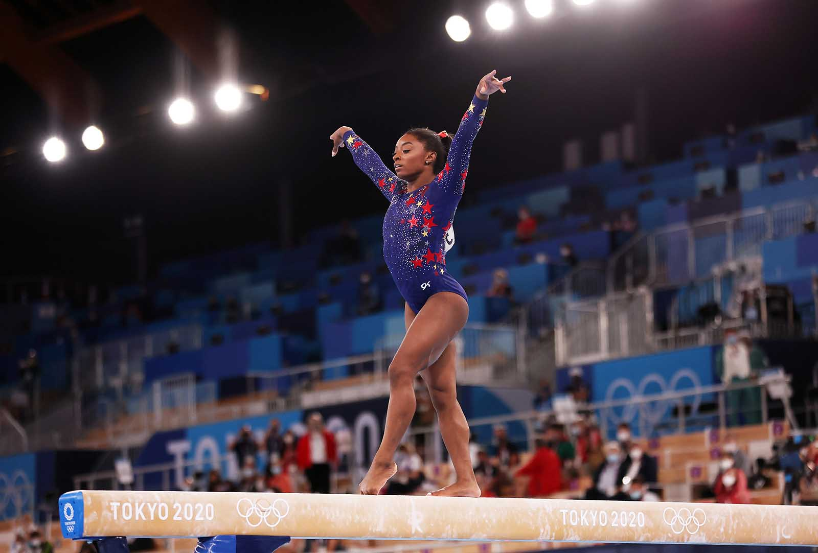 Simone Biles is pictured competing on balance beam on July 25.