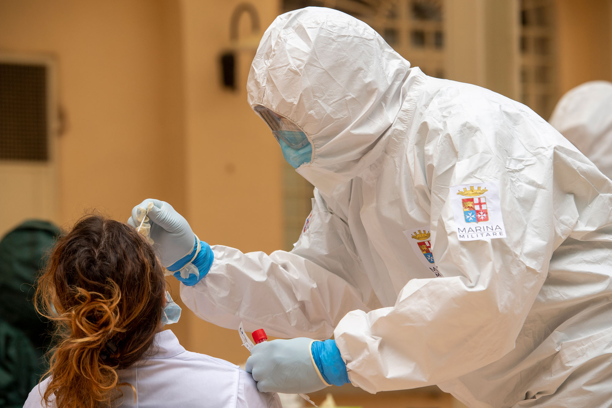 An Italian Navy doctor administers a Covid-19 test inside a health facility on May 21 in Tempio Pausania, Italy.