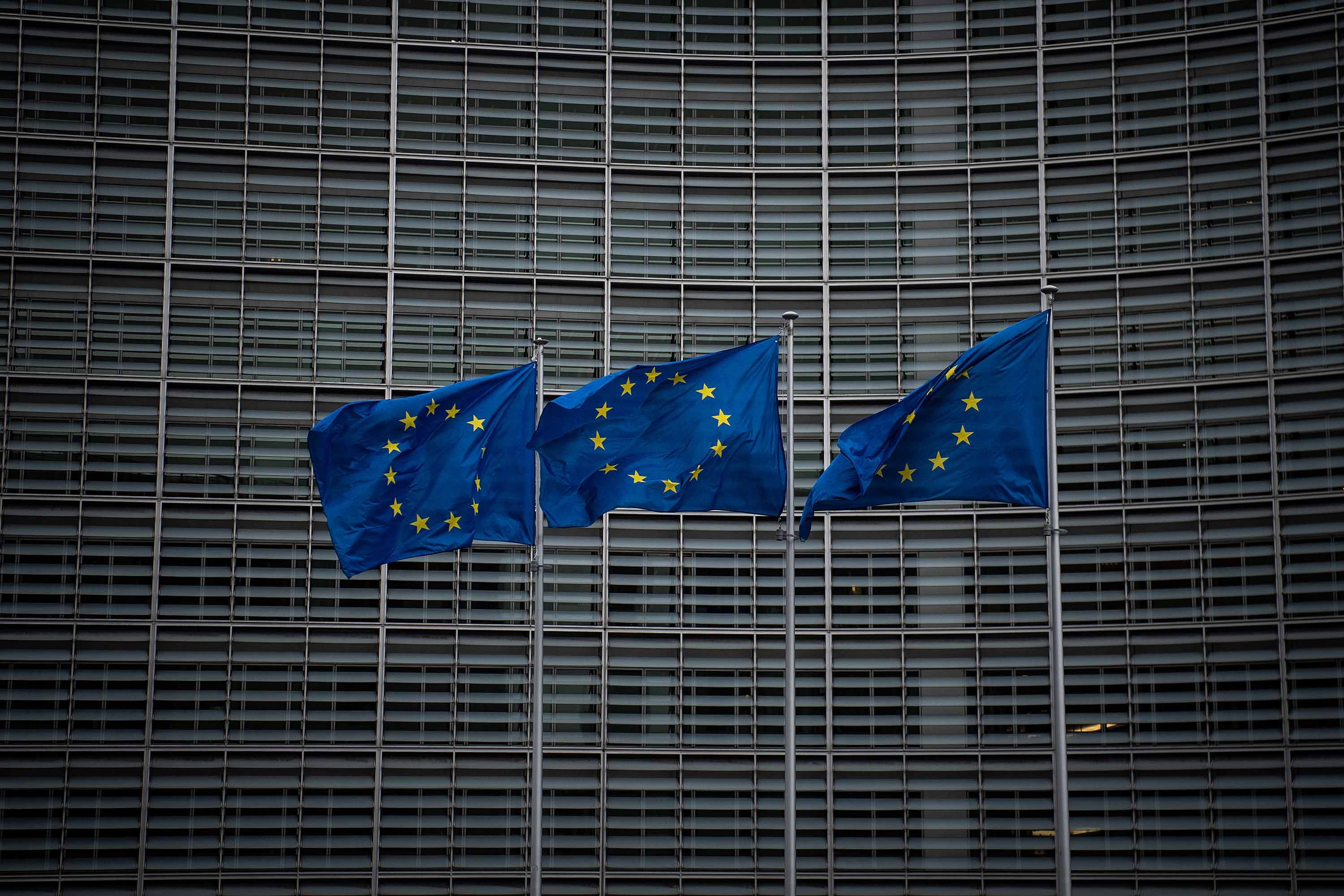 European Union flags are seen outside the European Commission on March 2, in Brussels, Belgium.