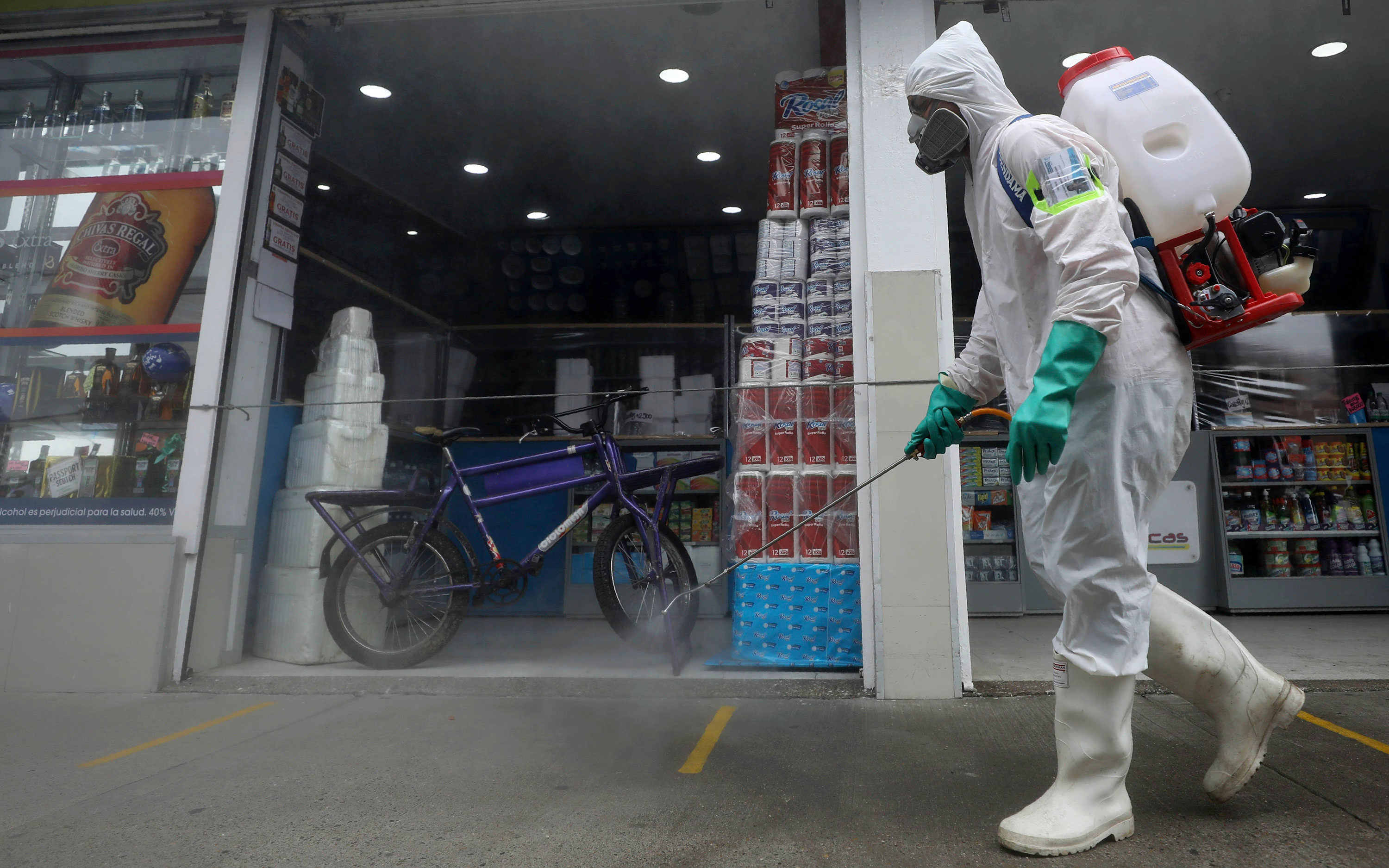 A worker sprays disinfectant on June 23 in Bogota, Colombia.