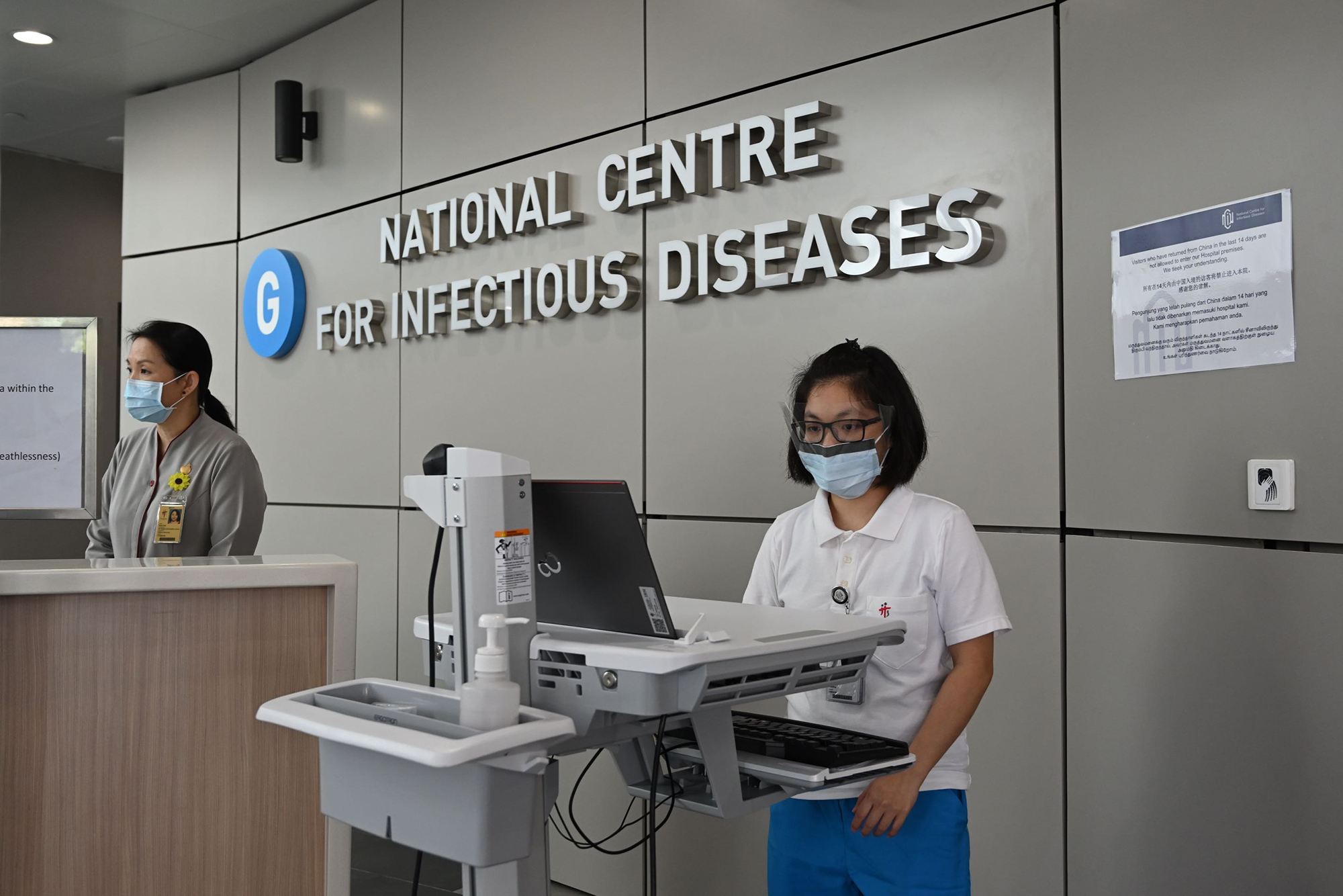Medical staff at the National Centre for Infectious Diseases building at Tan Tock Seng Hospital in Singapore on January 31.