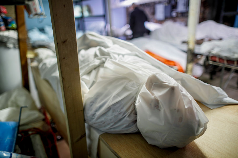 Bodies are wrapped in protective plastic in a holding facility at the Daniel J. Schaefer Funeral Home on Thursday, April 2. Funeral directors are seeing a surge of clients because of the coronavirus pandemic.