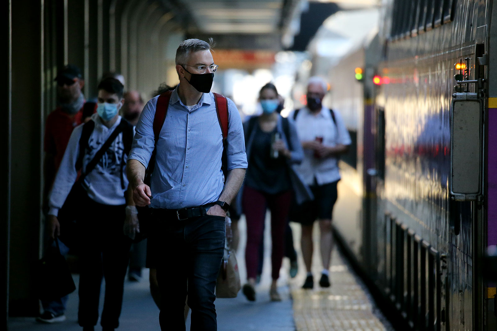 Commuters in Boston wear masks at South Station on July 14.