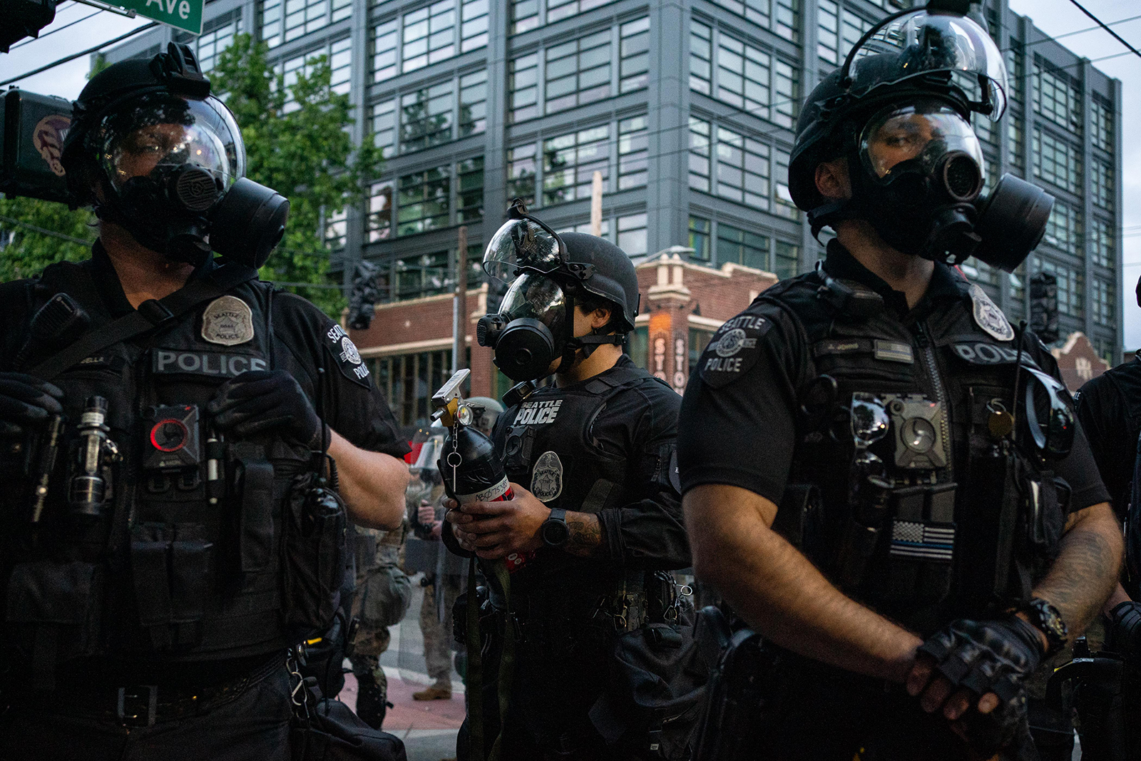 Police officers face off with demonstrators near the Seattle Police Department's East Precinct in Seattle, on June 6.