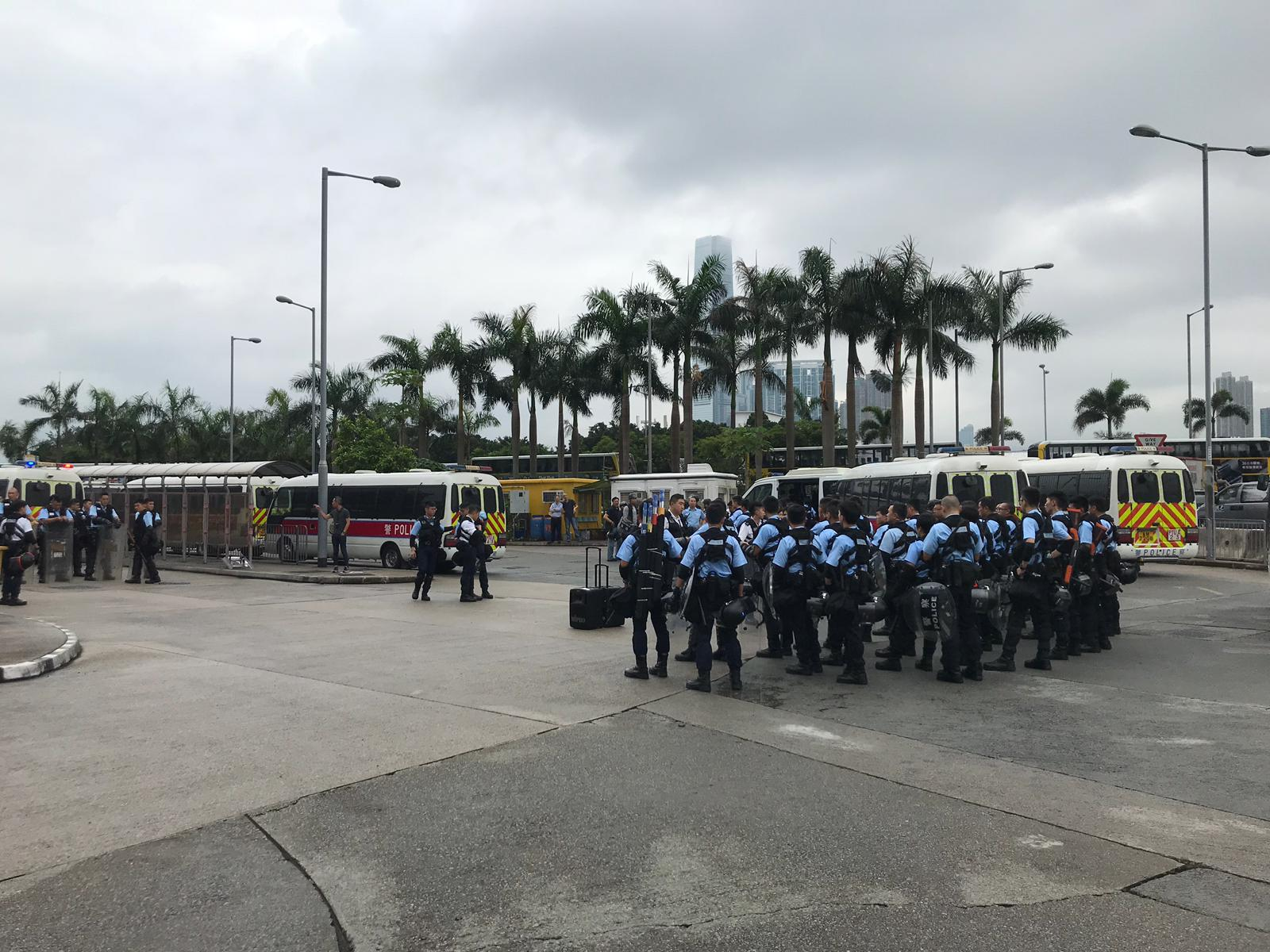 Police reinforcements gather by the International Finance Center in Hong Kong.