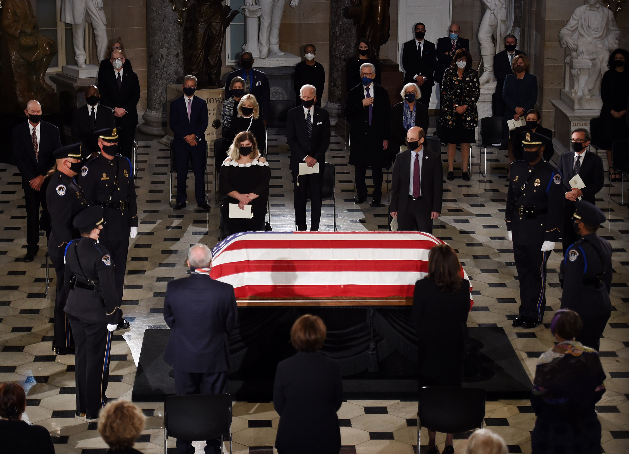 Members of Congress and guests pay their respects to the late Associate Justice Ruth Bader Ginsburg as her casket lies in state during a memorial service in her honor in the Statuary Hall at the US Capitol in Washington, DC, on September 25.