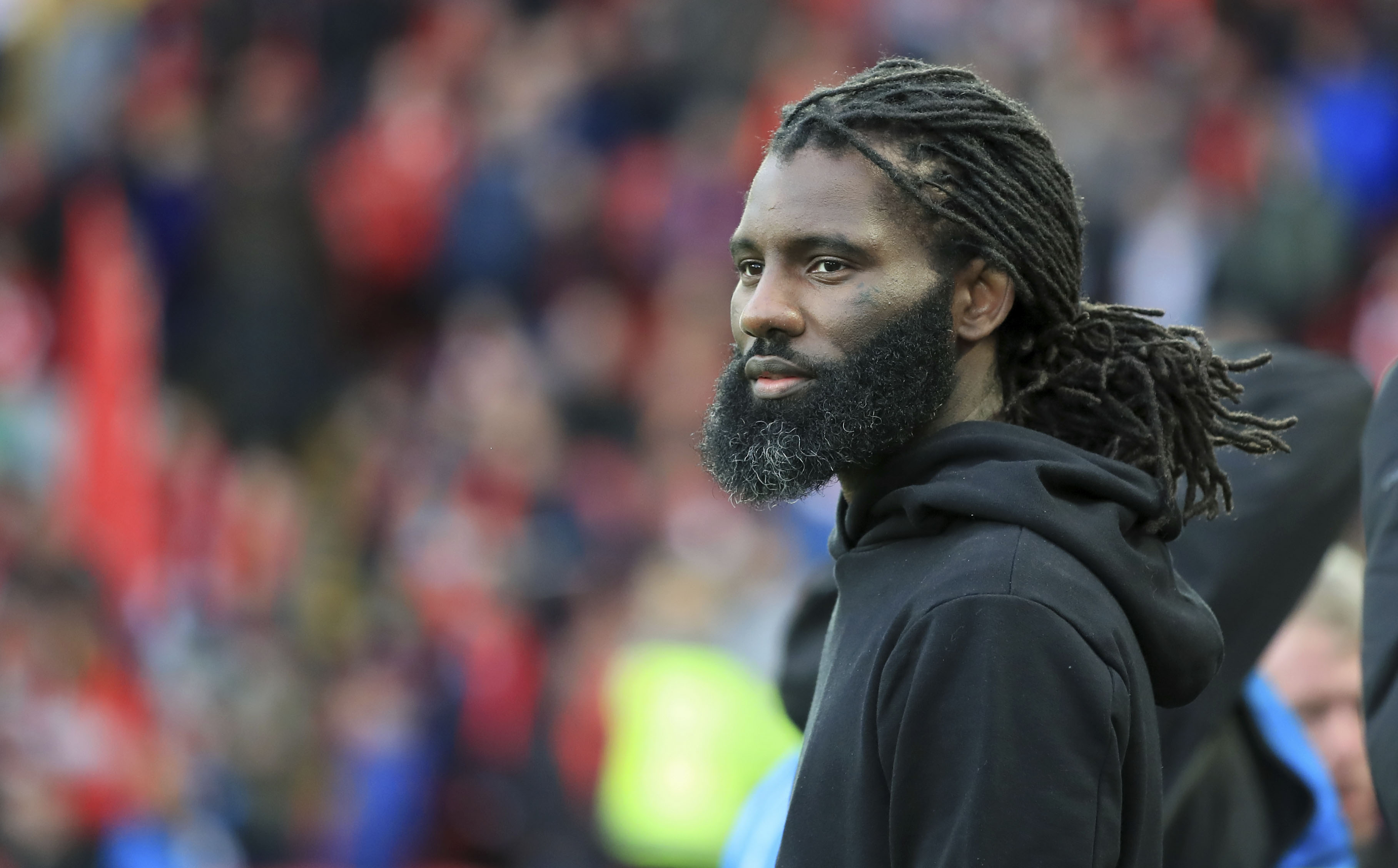 Wretch 32 attends a UEFA Champions League match in Liverpool, England, on May 7, 2019.