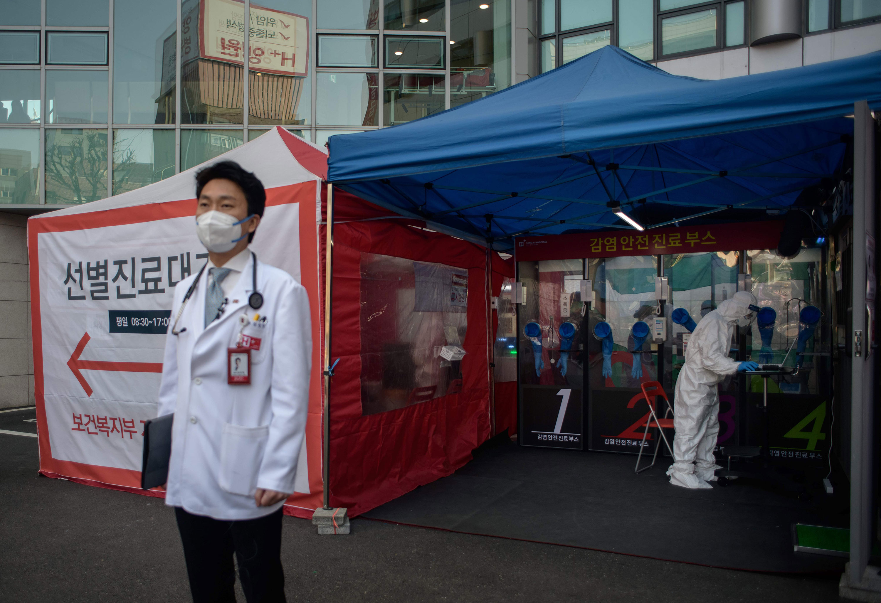 Hospital president Kim Sang-il stands outside a coronavirus testing booth at Yangji hospital in Seoul on March 17.