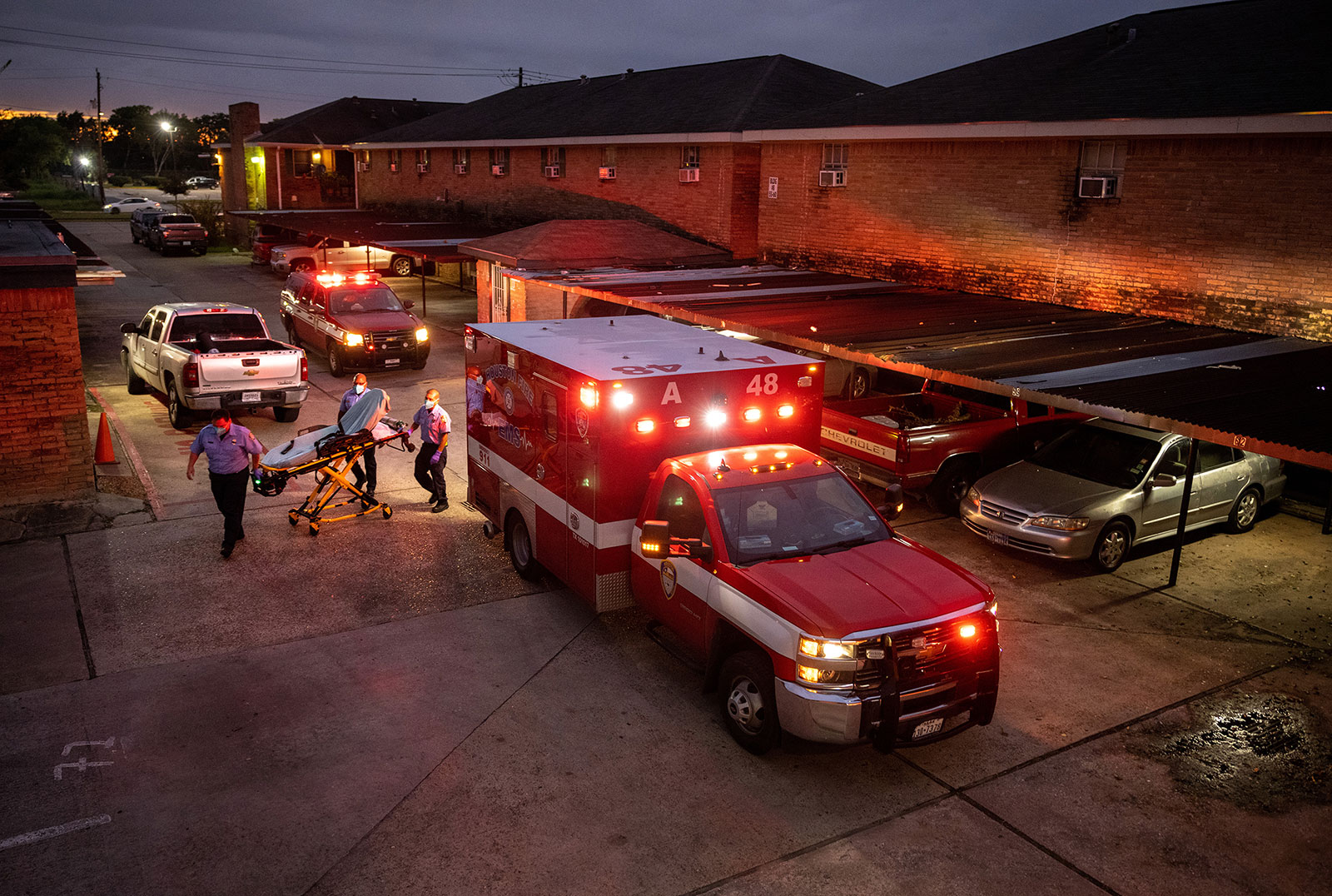 Paramedics prepare to transport a Covid-19 patient to a hospital in Houston, Texas, on September 15.