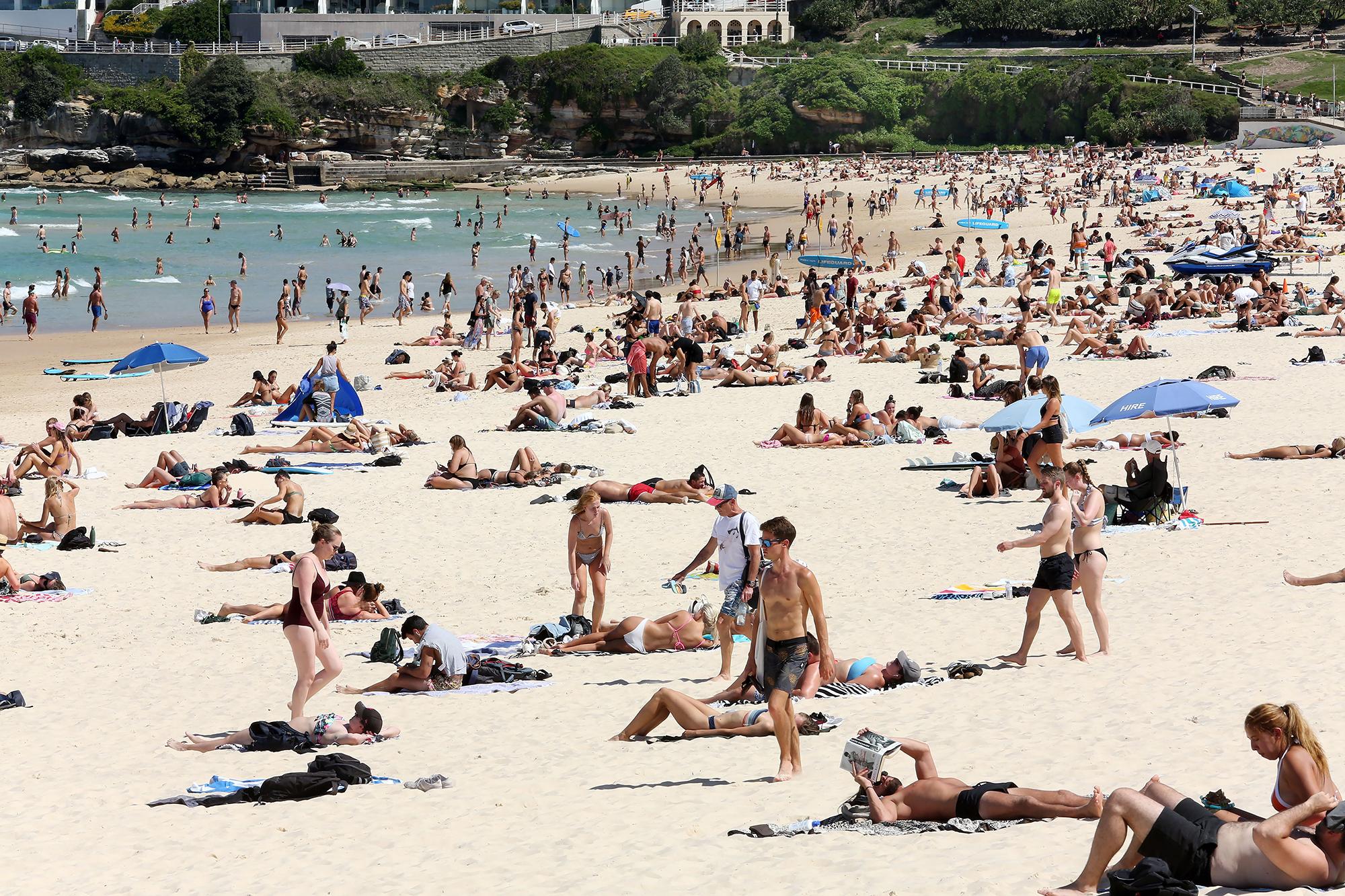 Beachgoers swarm Bondi in Sydney, Australia, on Friday.