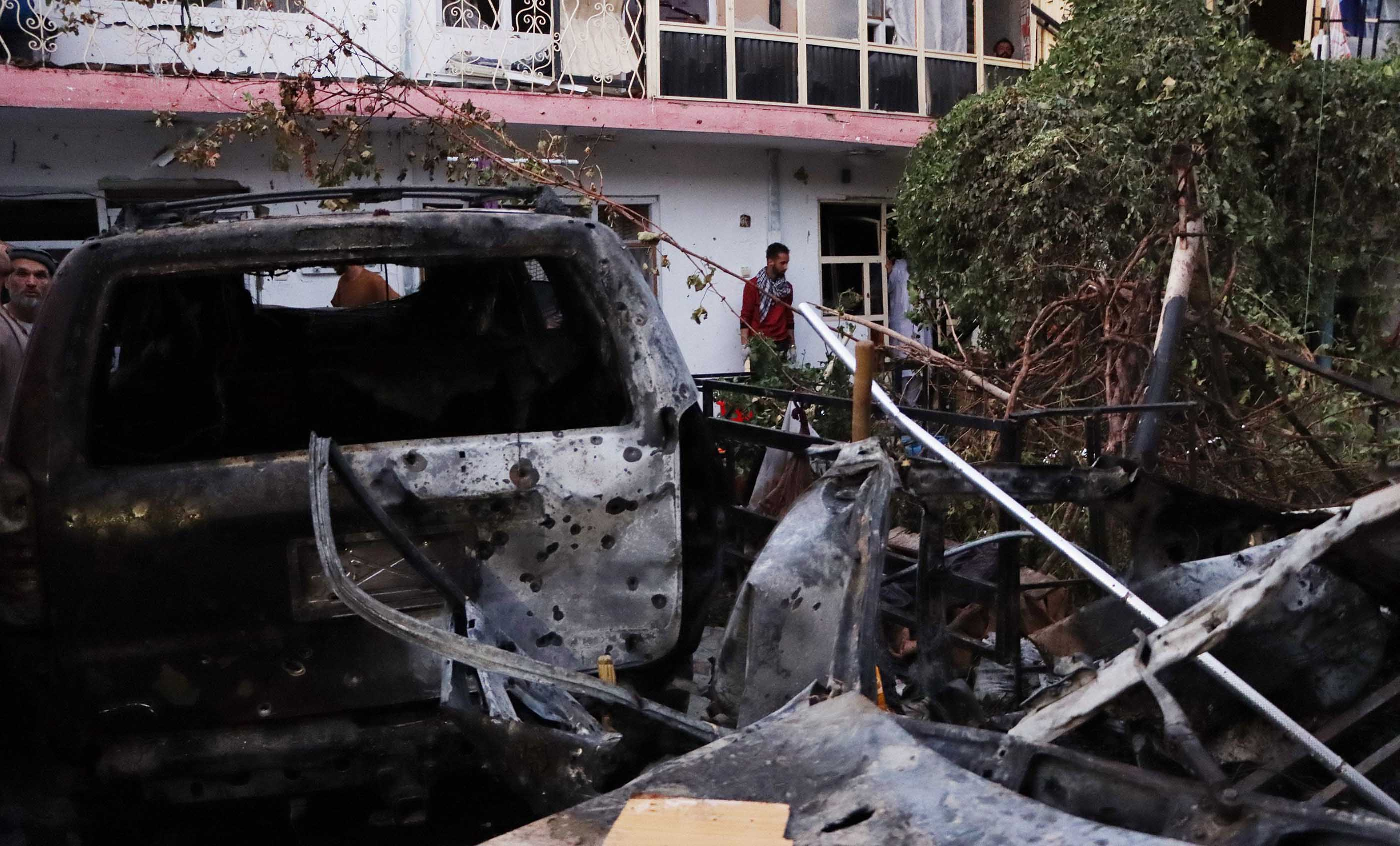 """A damaged car is seen aftera US drone strikereportedly targeted a suspected ISIS-K suicide bomber who posed an """"imminent"""" threat in Kabul, Afghanistan, on Sunday, August 29."""