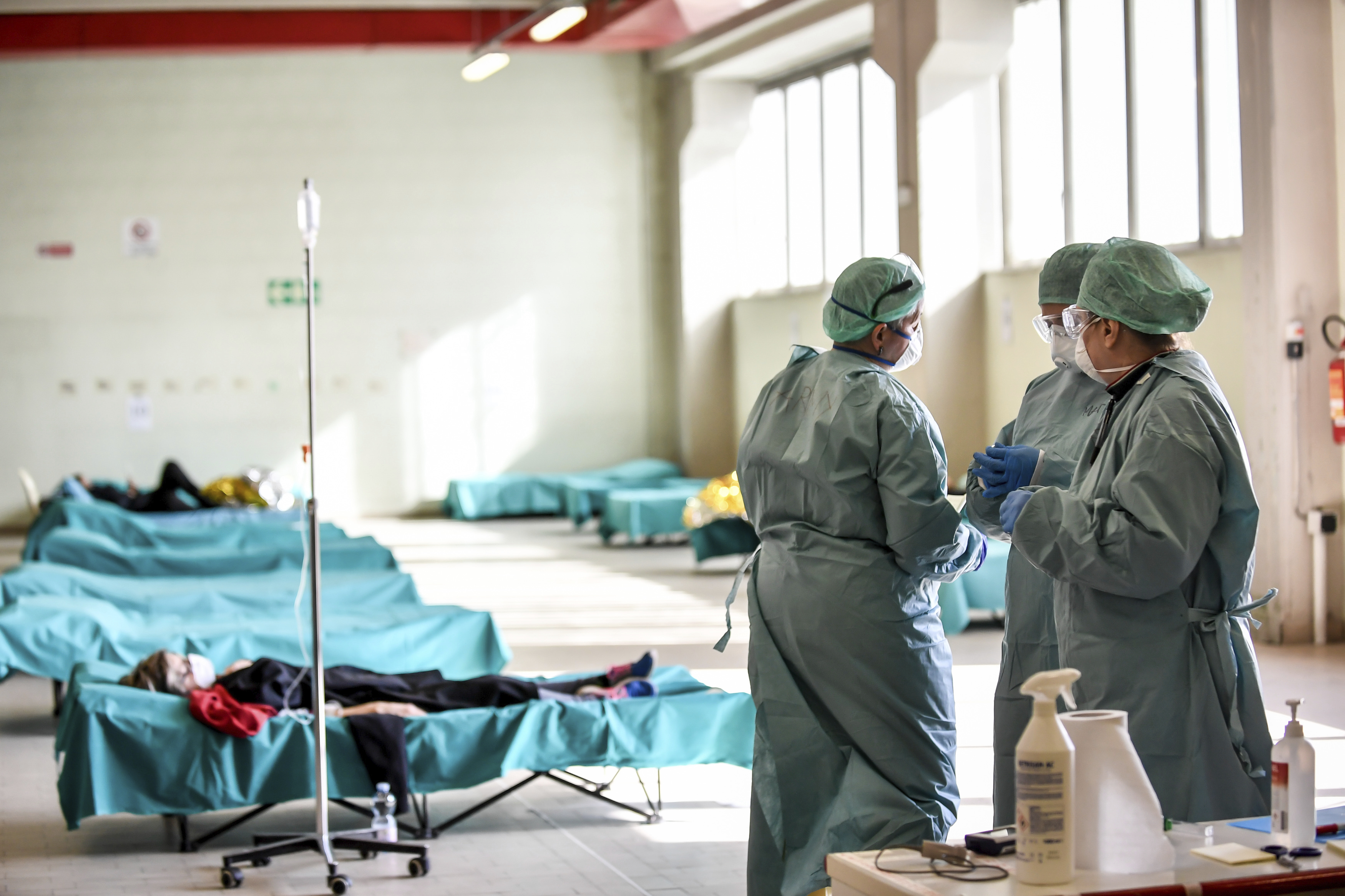 Medical personnel work inside one of the emergency structures that were set up to ease procedures at the hospital of Brescia, in Northern Italy, on Tuesday, March 10.