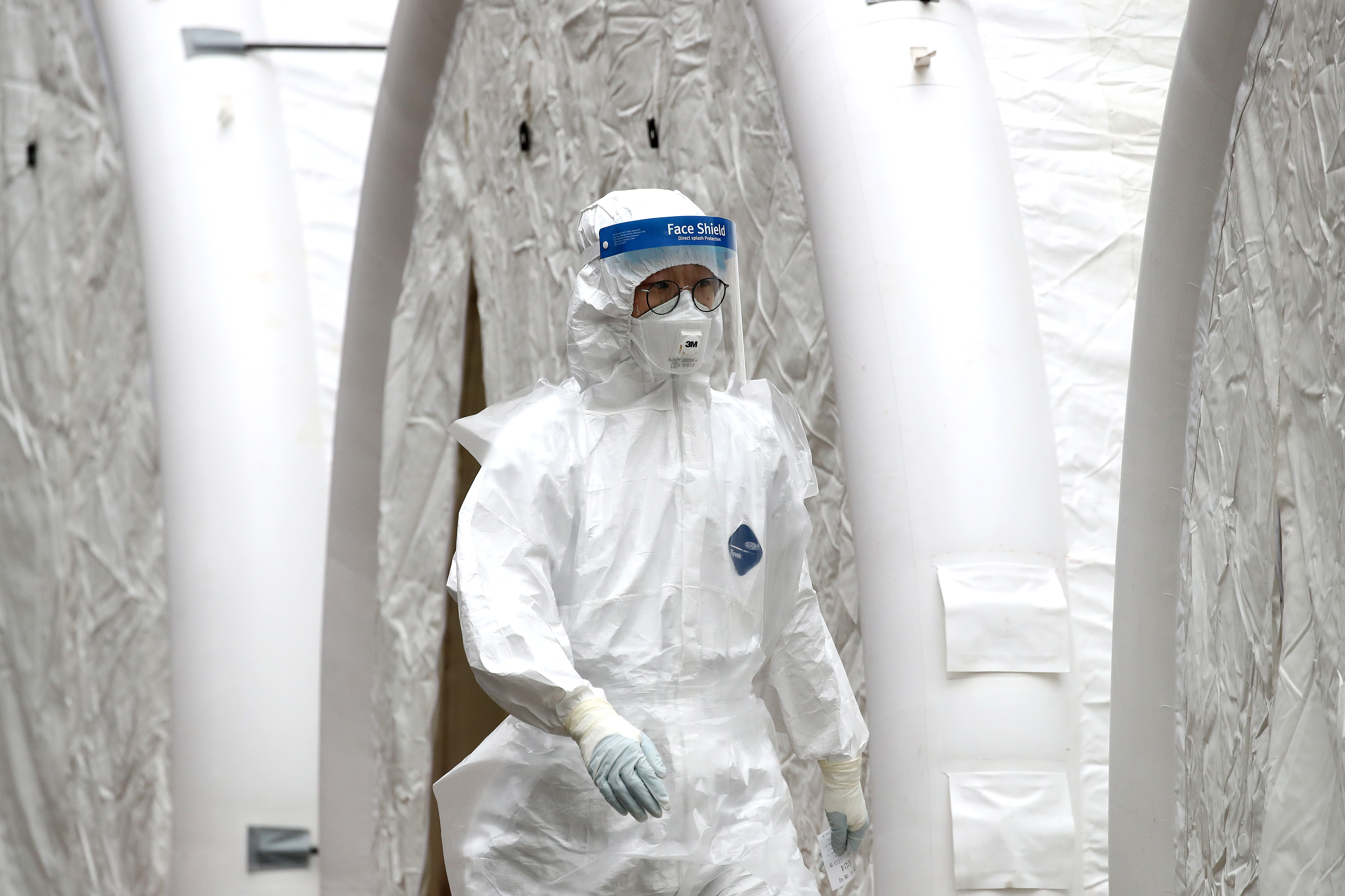 A medical worker at a preliminary testing facility at the National Medical Center where patients suspected of contracting coronavirus are assessed in Seoul.