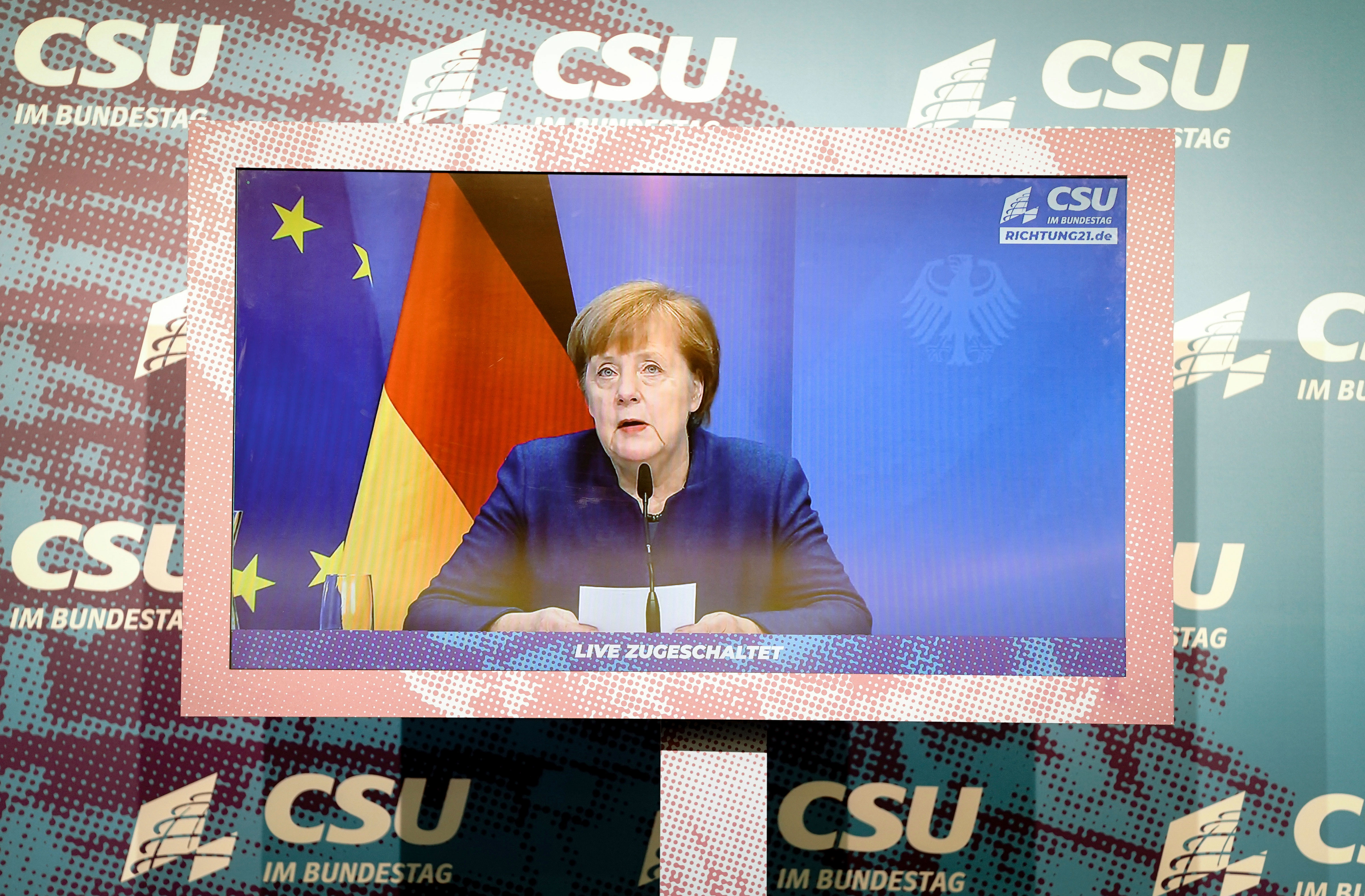 German Chancellor Angela Merkel makes a statement in Berlin on January 7 — about the previous day's riots in Washington, DC — during a Christian Social Union parliamentary group digital press conference.