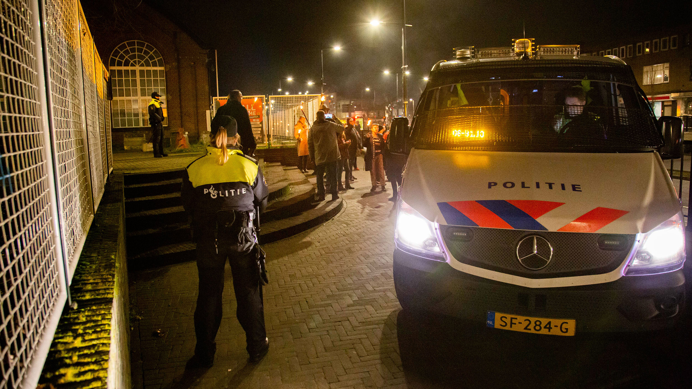Police monitor demonstrators protesting against Covid-19 lockdown and curfew measures in Tilburg, Netherlands, on February 5.