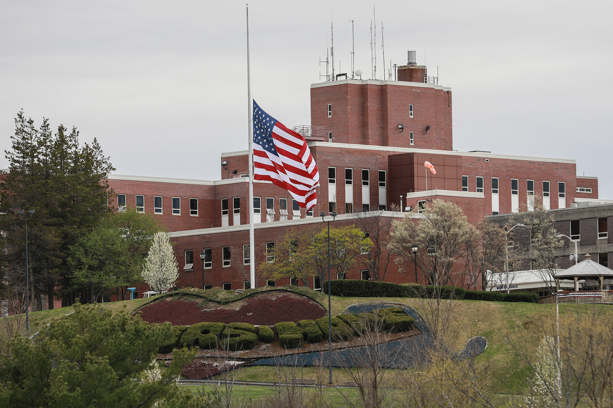 An American flag flies at half-mast outside the Holyoke Soldiers' Home on April 29, 2020 in Holyoke, Massachusetts.