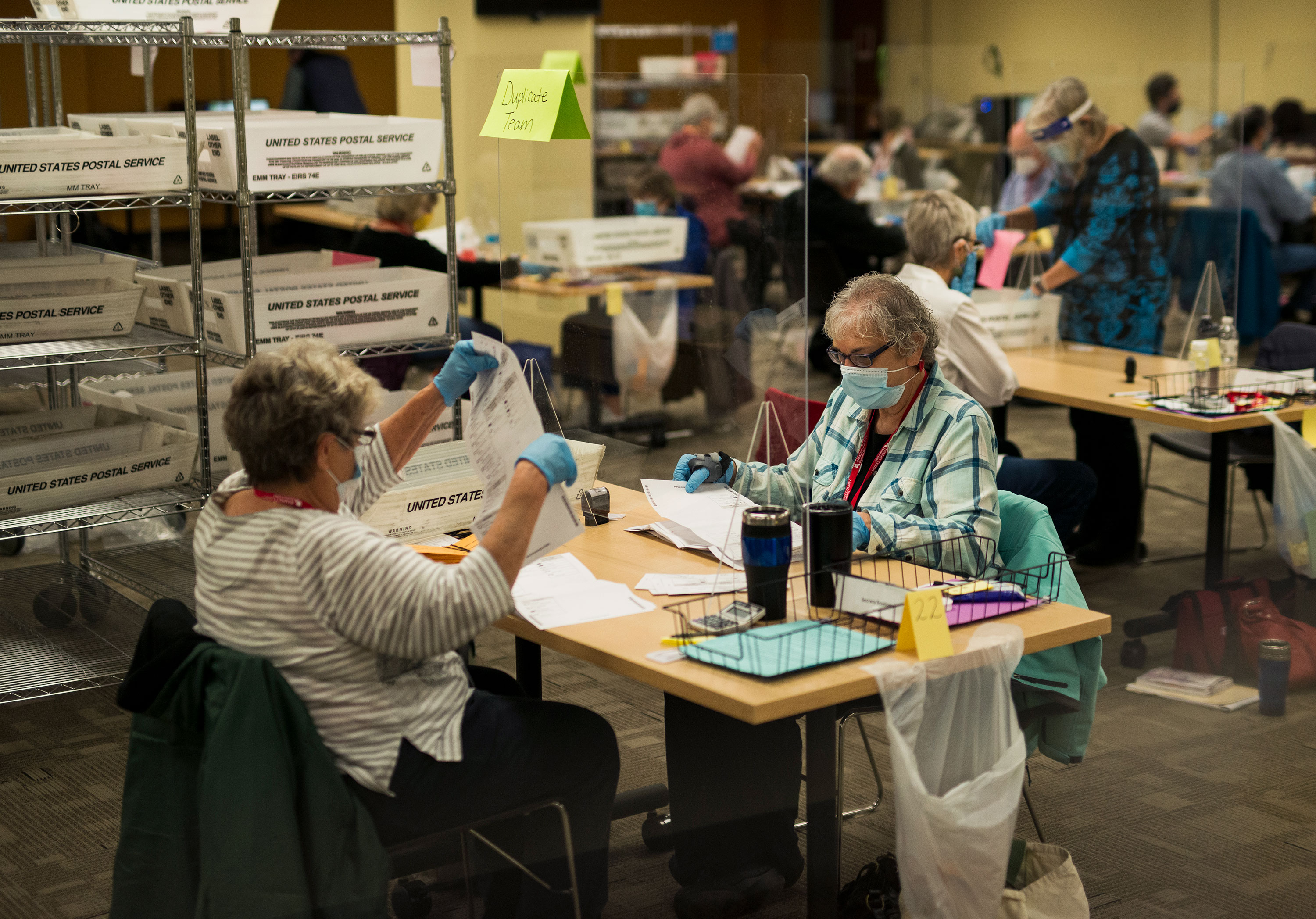 Volunteers process absentee ballots at Ramsey County's absentee ballot count center on November 2 in St Paul, Minnesota.