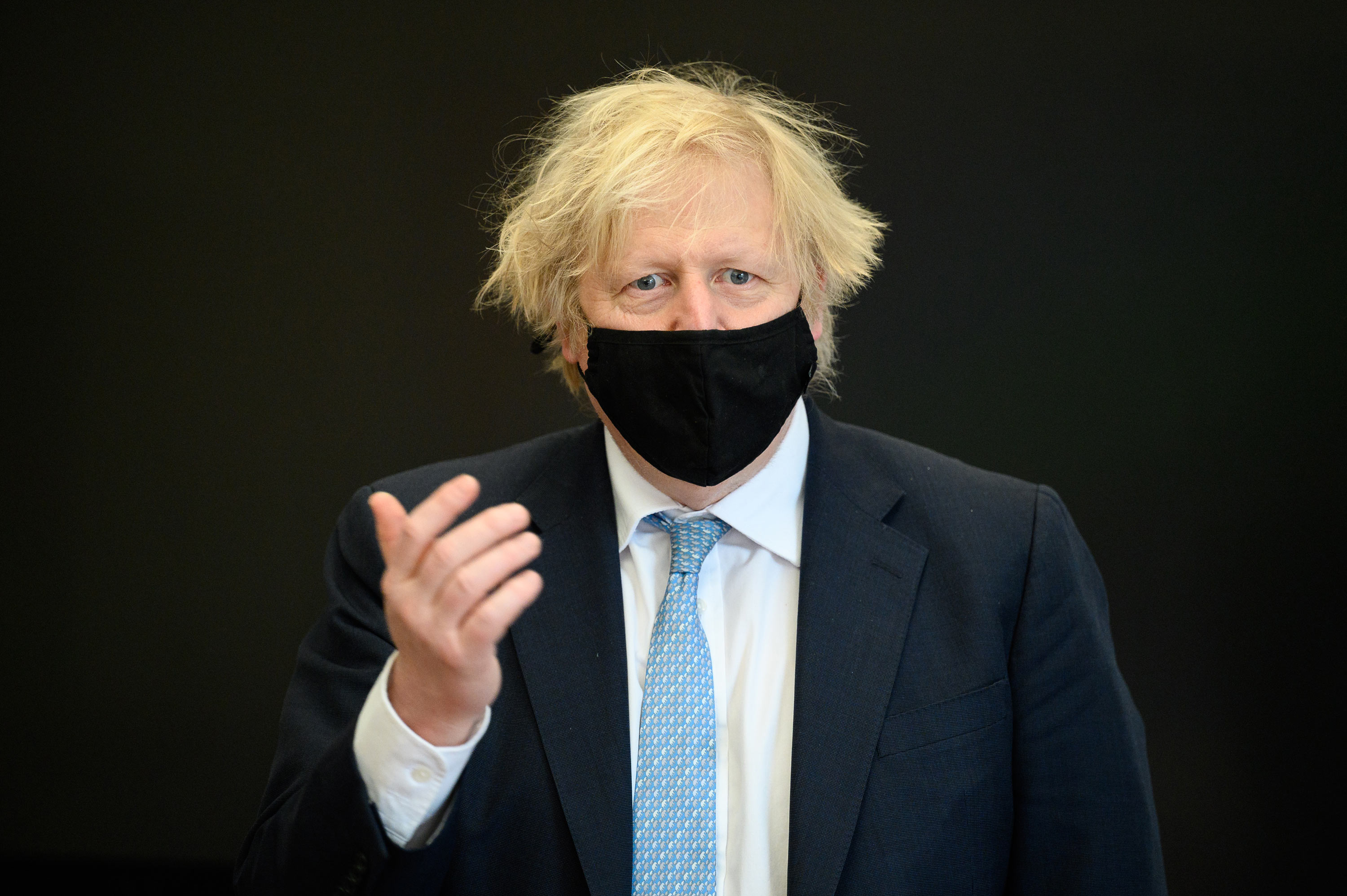 Prime Minister Boris Johnson speaks at Colham Manor primary school during a constituency visit on March 18 in Uxbridge, England.