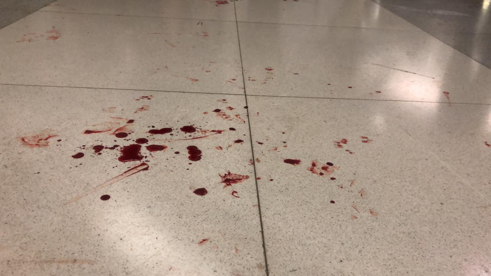 Blood stains seen on the floor of the subway station after police stormed it.