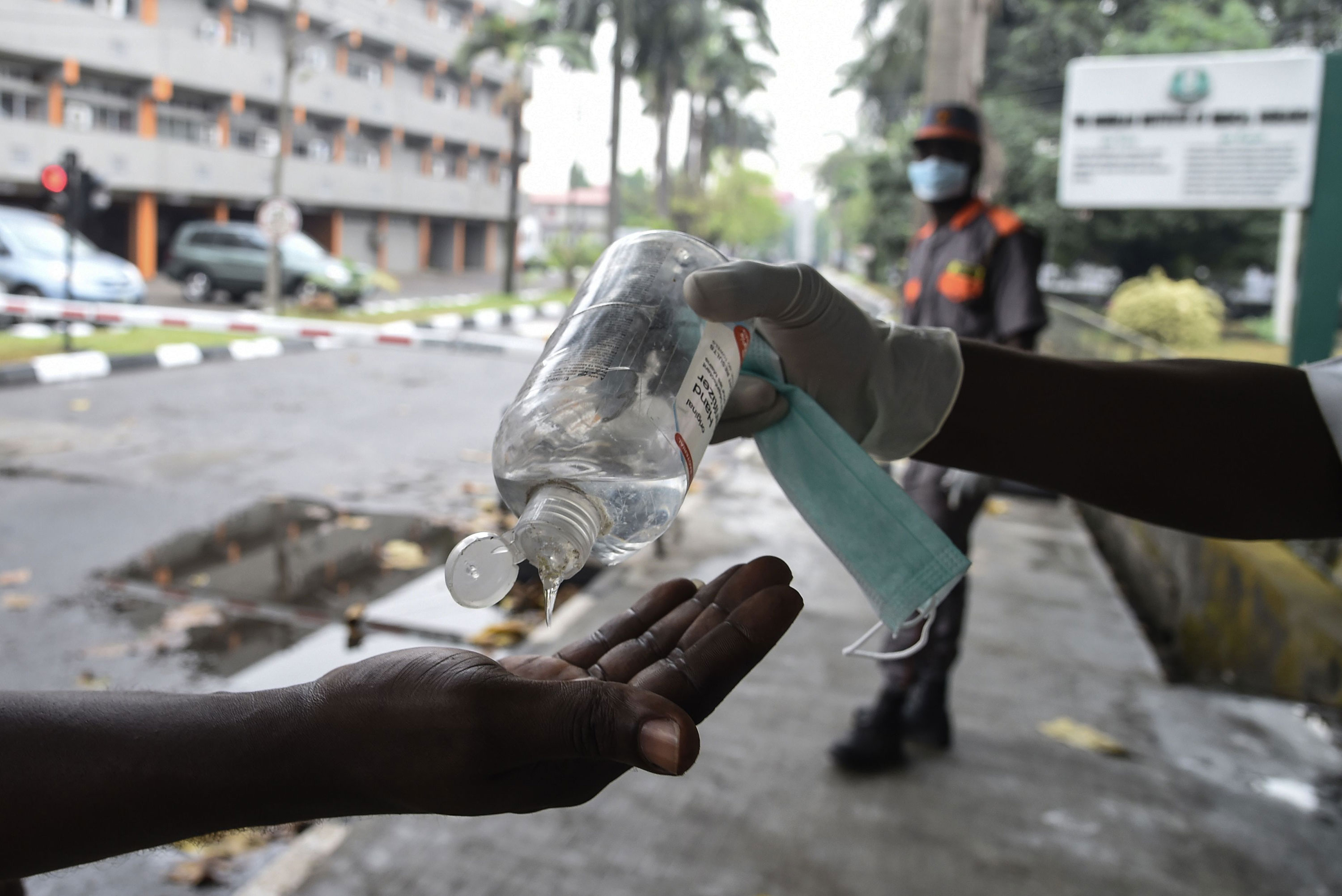 A person has their hands sanitized before entering a state hospital in Lagos, Nigeria, on February 28.