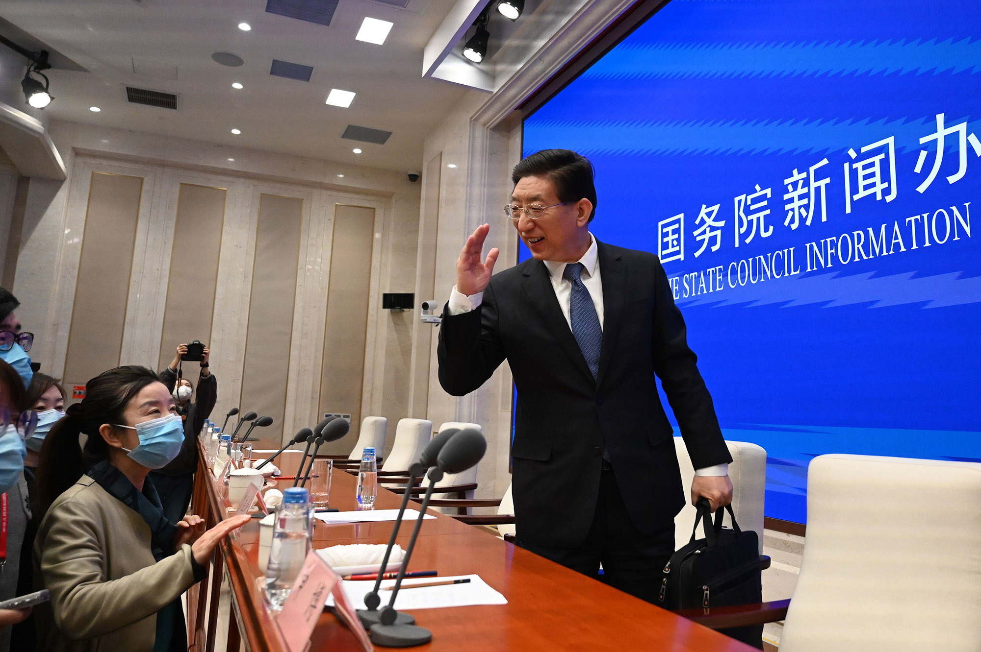 Zeng Yixin, a vice-minister of China's National Health Commission, leaves following a news conference in Beijing on Friday.