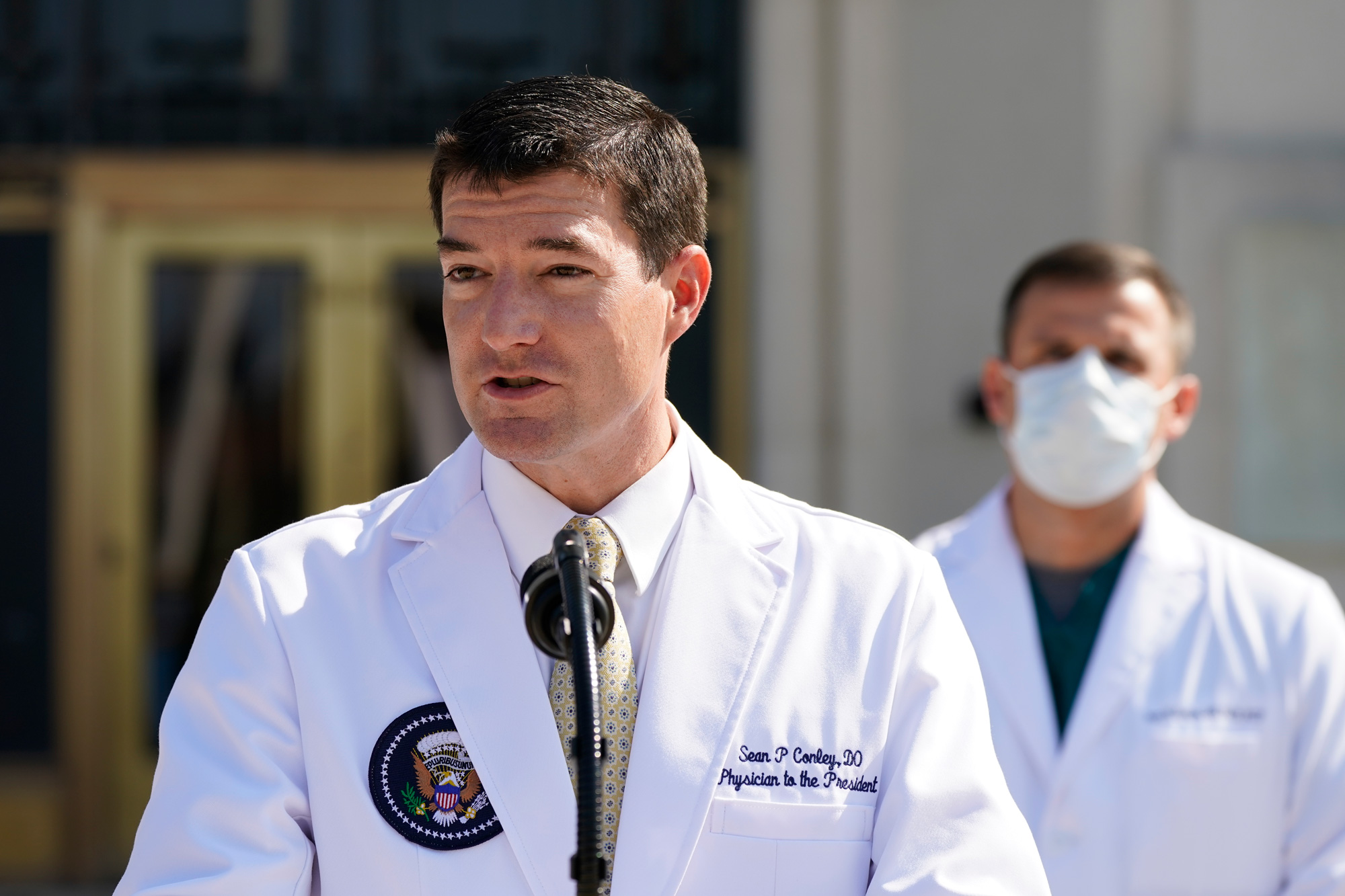 Dr. Sean Conley, physician to President Donald Trump, briefs reporters at Walter Reed National Military Medical Center in Bethesda, Maryland, on October 4.