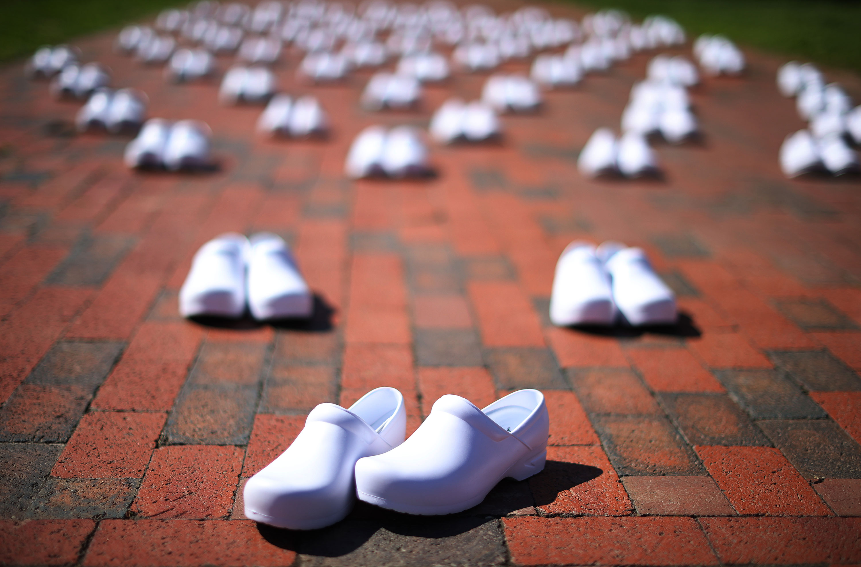 The National Nurses United set out 88 empty pairs of shoes on May 7 in Washington representing nurses that they say have died from COVID-19.