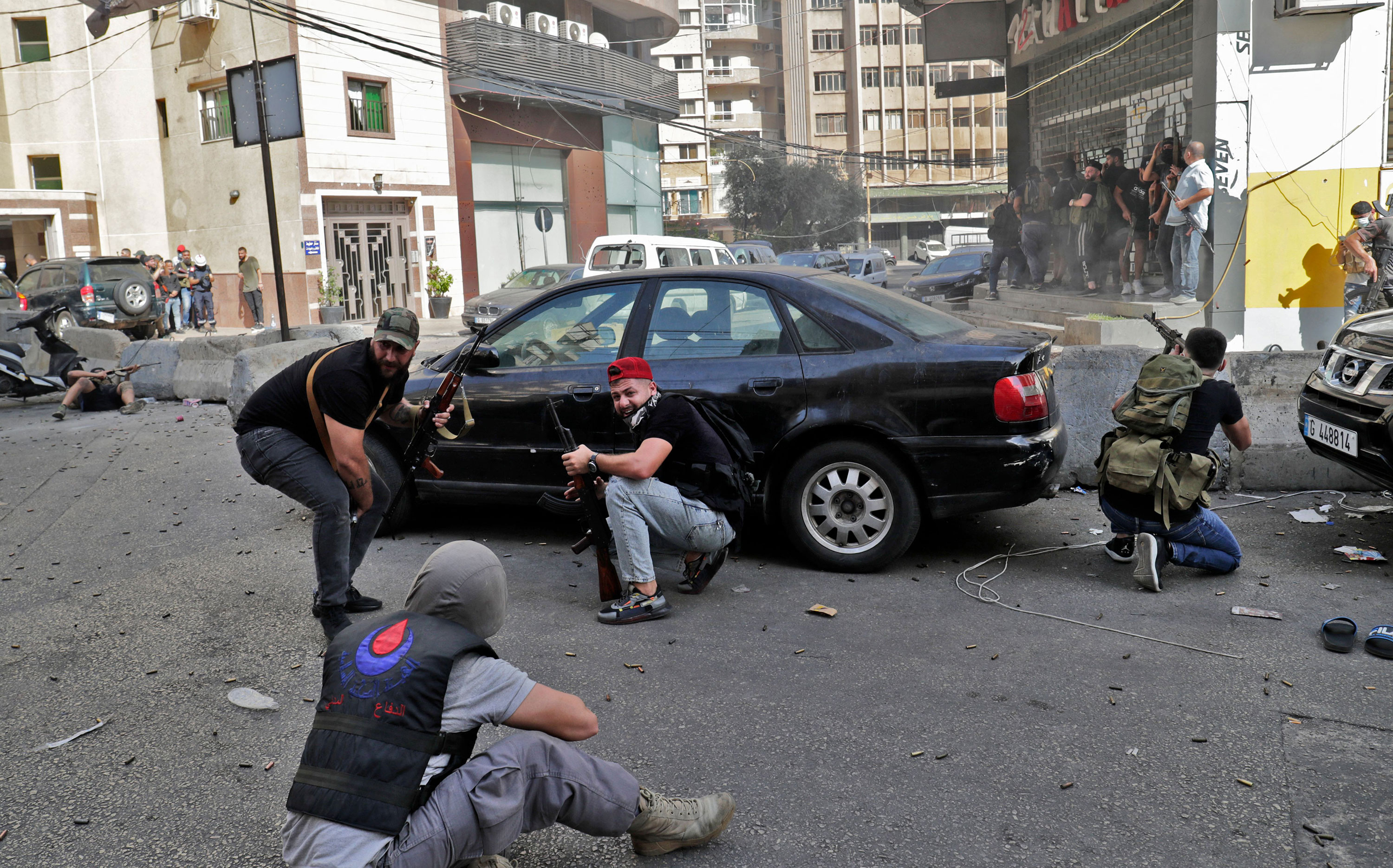 Fighters from the Hezbollah and Amal movements are seen during clashes in Beirut on Thursday.