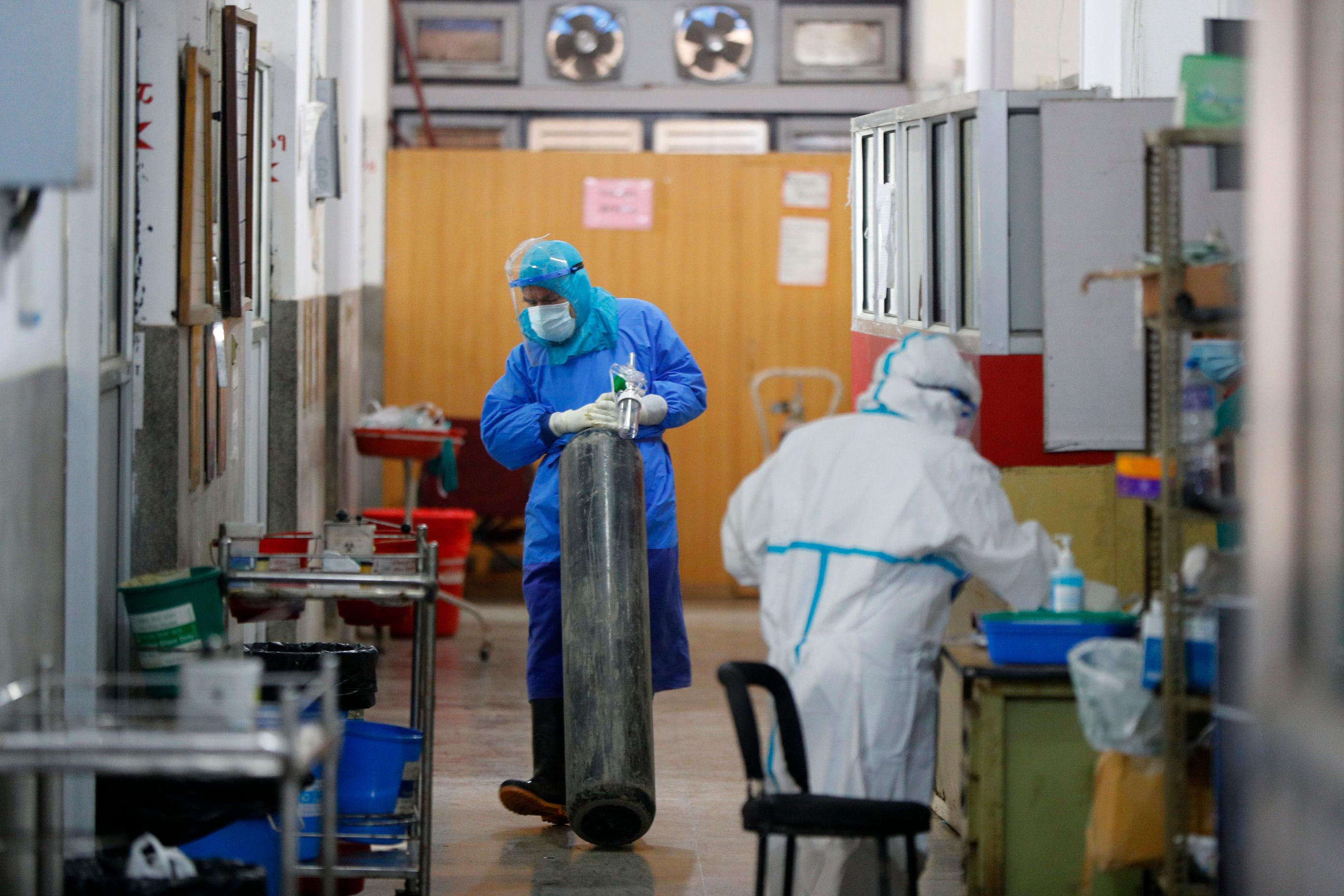 A health worker holds an oxygen cylinder inside a Covid-19 hospital ward in Kathmandu, Nepal, on April 26.