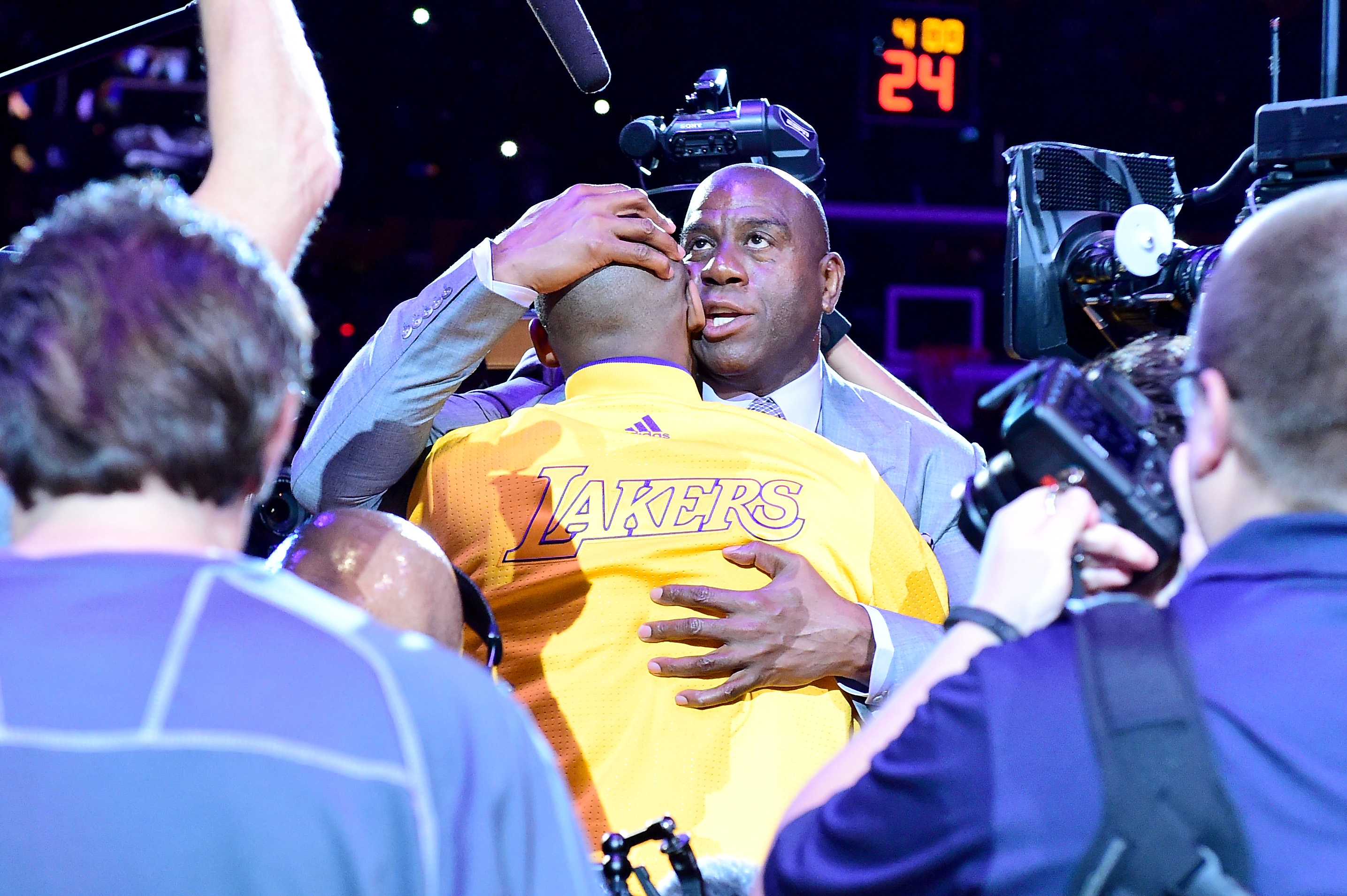 "Earvin ""Magic"" Johnson hugs Kobe Bryant of the Los Angeles Lakers before the game against the Utah Jazz at Staples Center on April 13, 2016 in Los Angeles,"