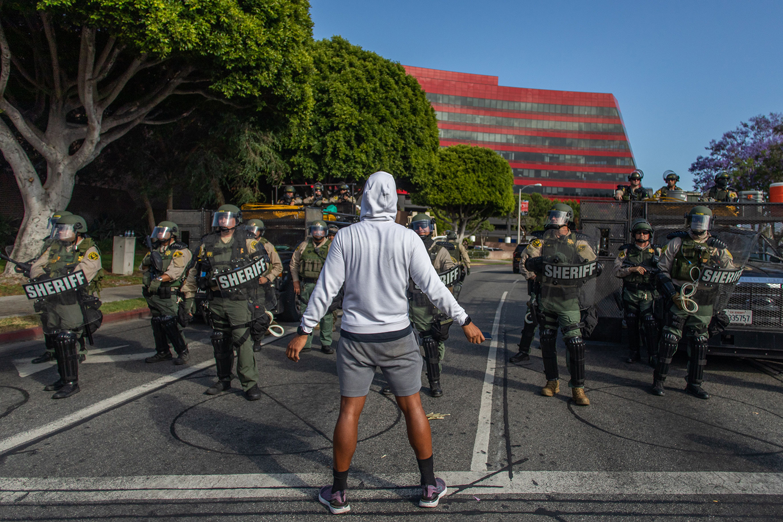 A demonstrator stands in front of West Hollywood Sheriffs Police Department during a peaceful protest in West Hollywood, California on June 6.