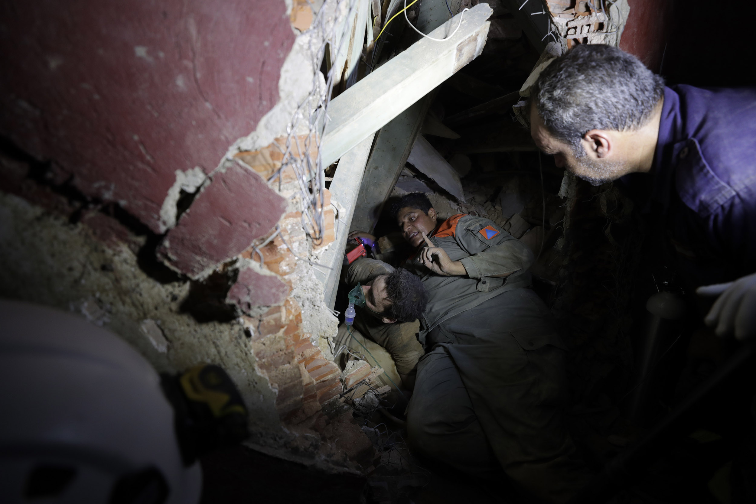 Lebanese soldiers search for survivors after a massive explosion in Beirut, Lebanon, on Wednesday, August 5.