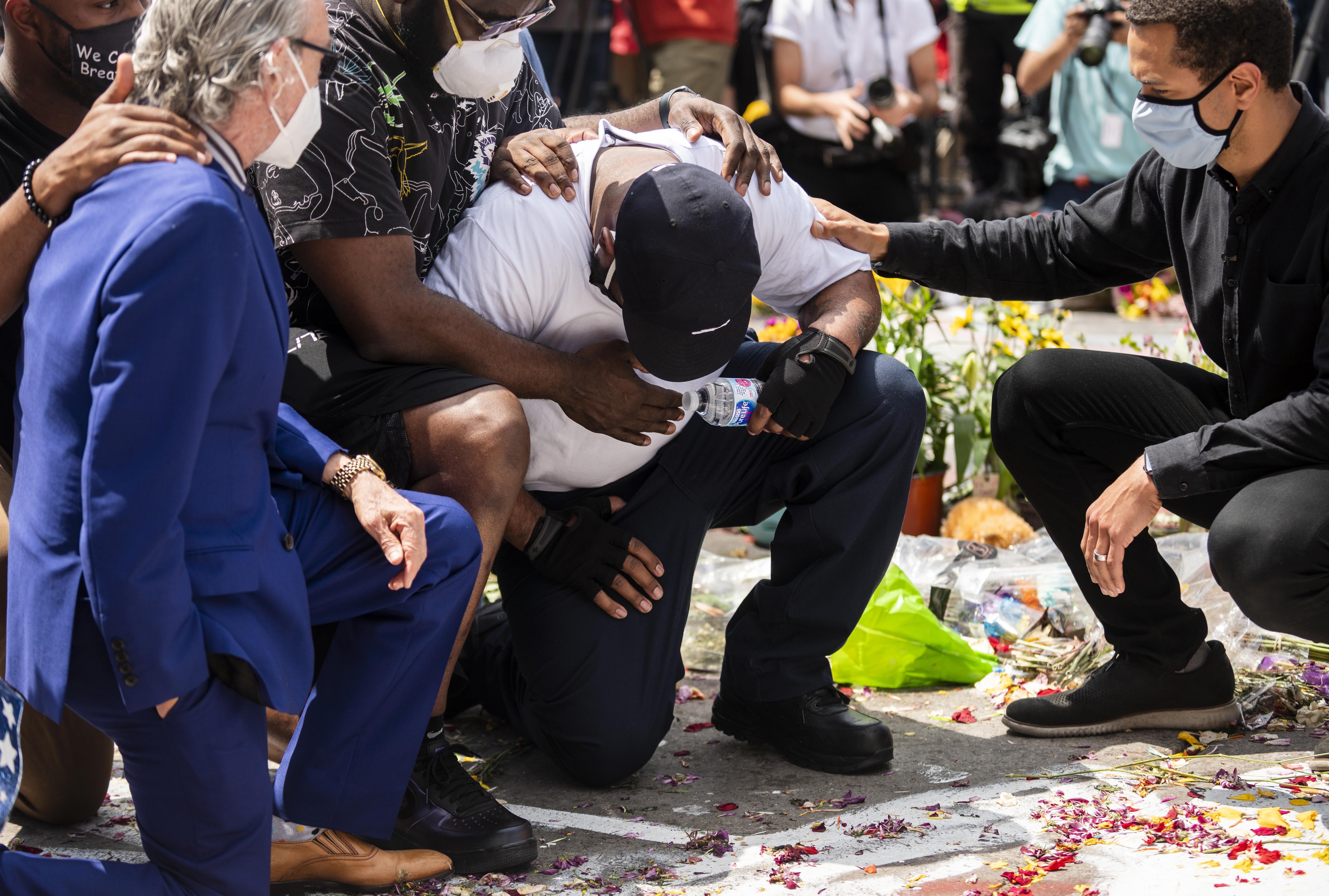 Terrence Floyd, George Floyd's brother, visits a makeshift memorial in Minneapolis on June 1.