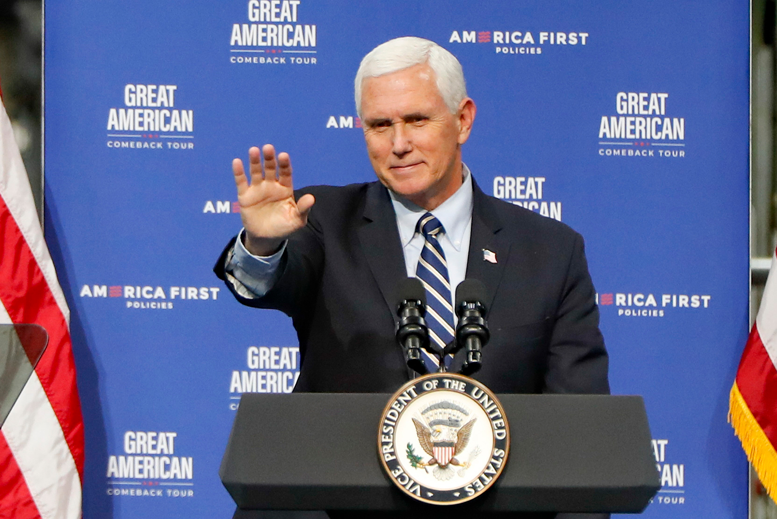 Vice President Mike Pence waves after speaking at Oberg Industries plant in Sarver, Pennsylvania on Friday, June 12.