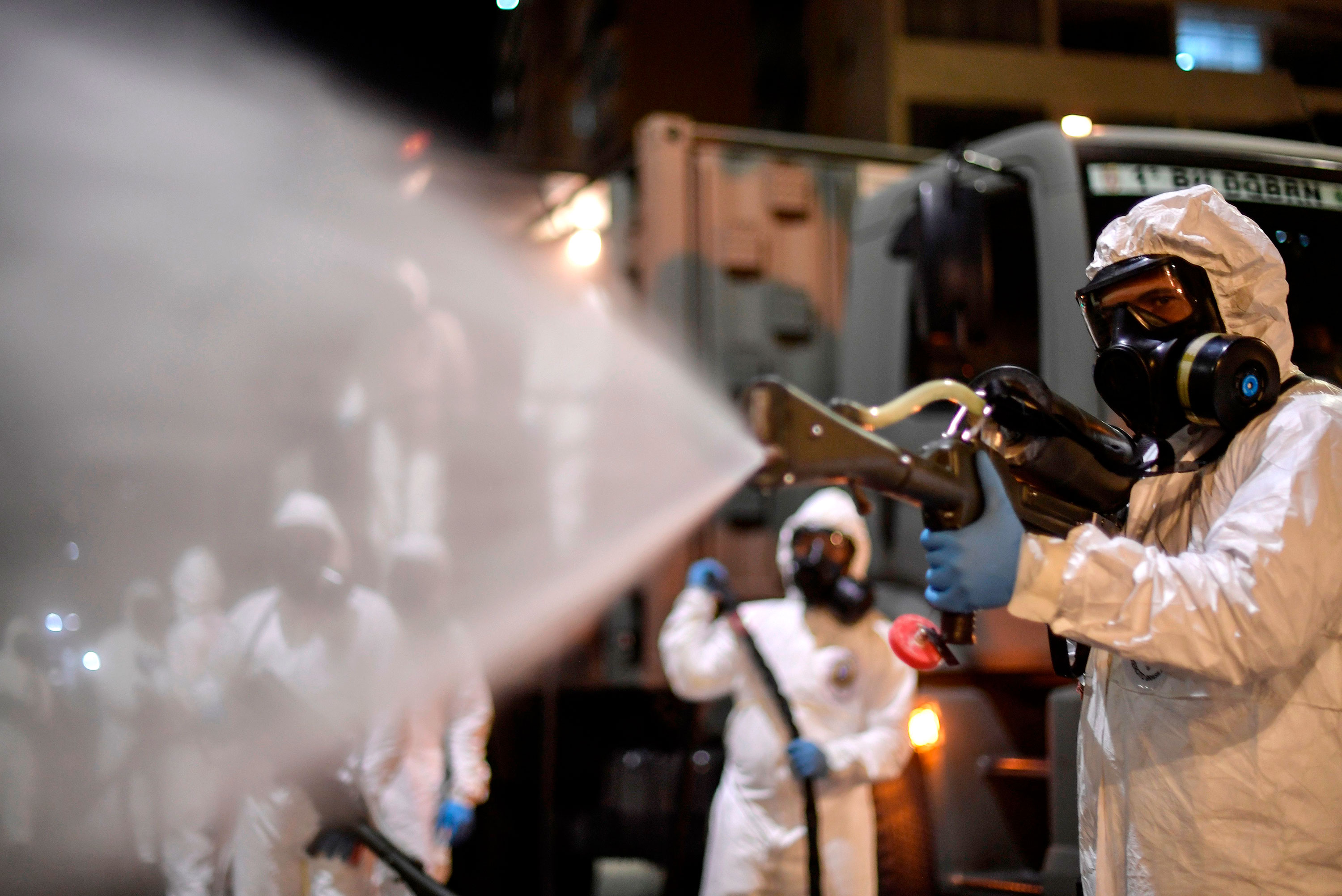 Soldiers spray disinfectant at the Municipal Market in the Belo Horizonte, Brazil, on August 18.