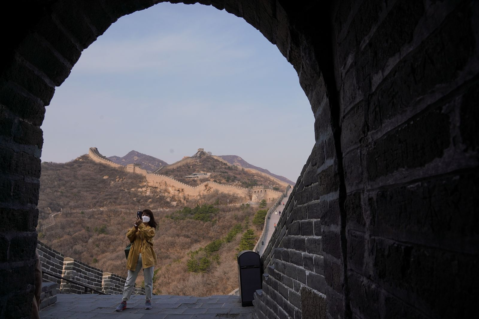 A tourist visiting the reopened Badaling section of the Great Wall of China on March 24.