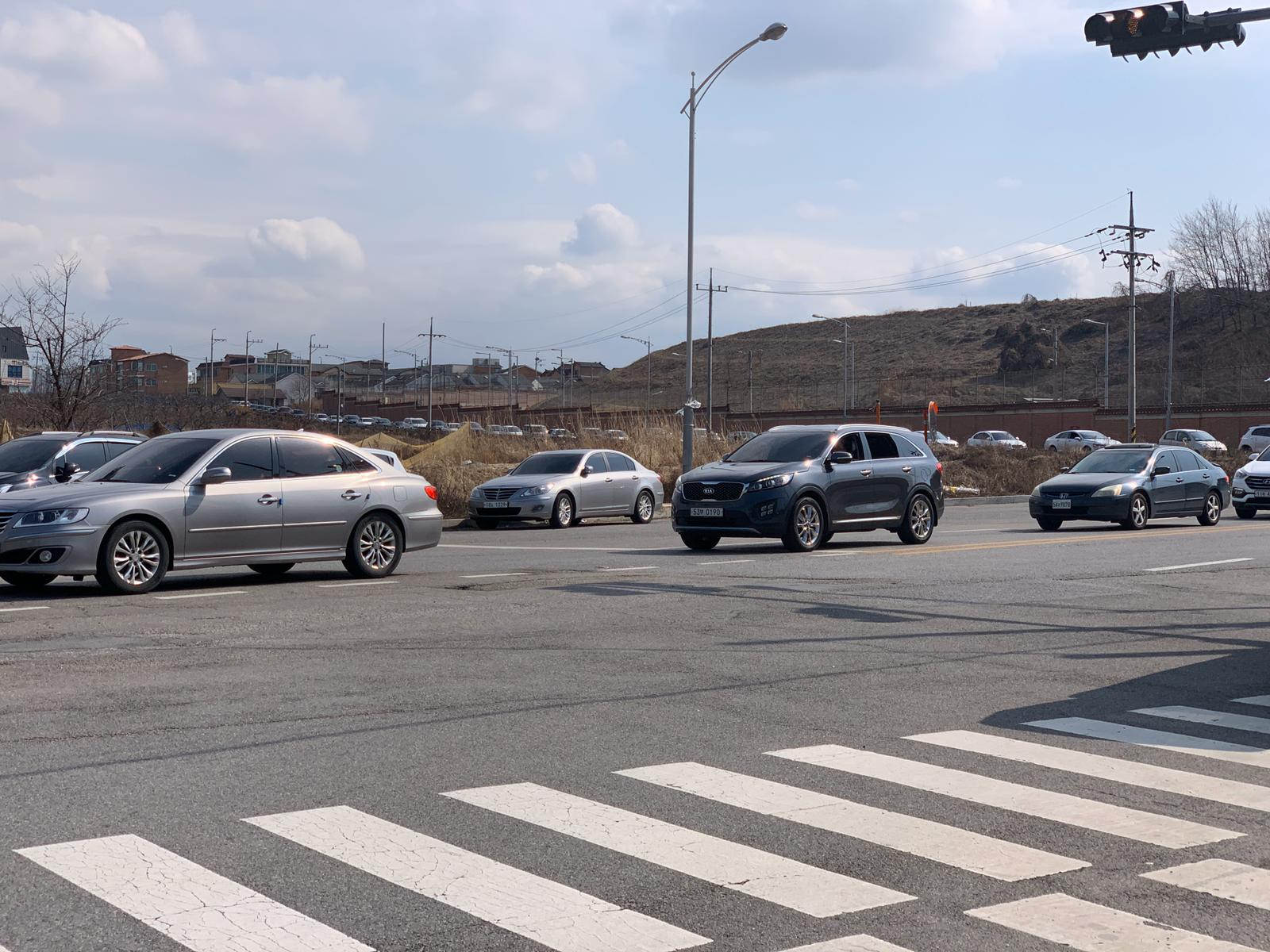 A long line of cars waiting hours to enter the military base Camp Humphreys in South Korea.