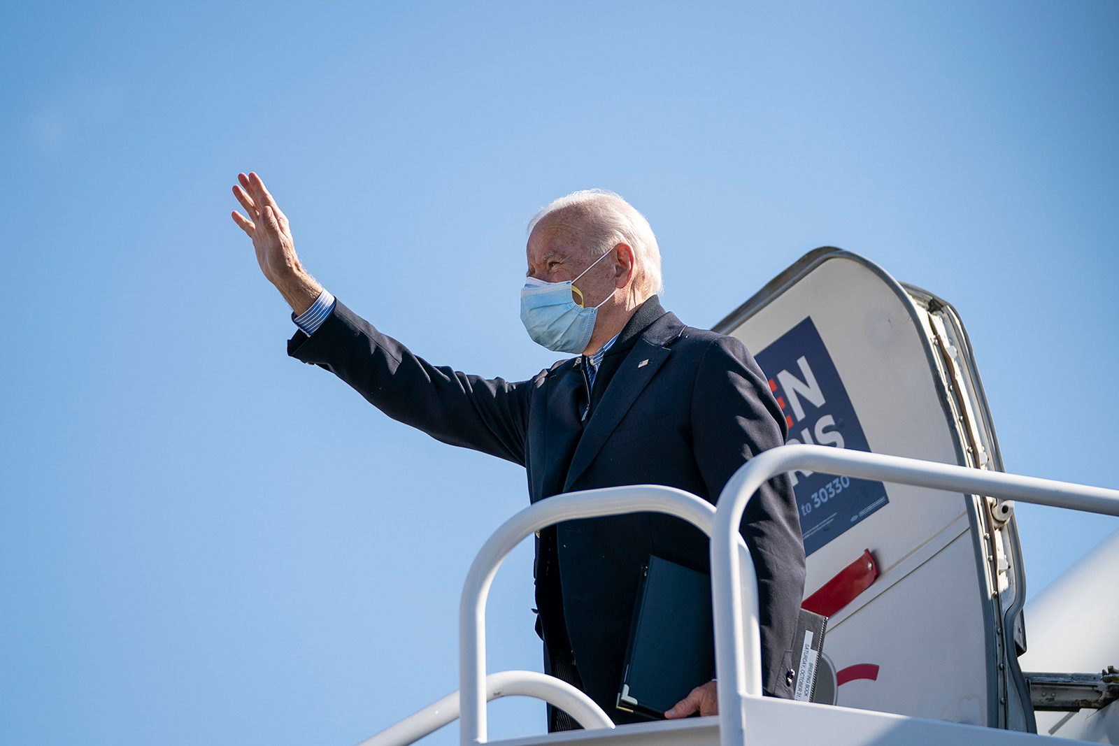 Democratic presidential nominee Joe Biden boards his campaign plane at New Castle Airport on October 31, in New Castle, Delaware.