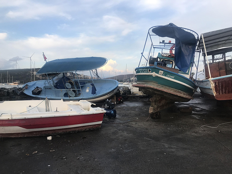 Anchored boats are seen damaged after a magnitude 7.0 quake shook Turkey's Seferihisar coastline in Izmir, Aegean Sea in Turkey, on October 30, 2020.