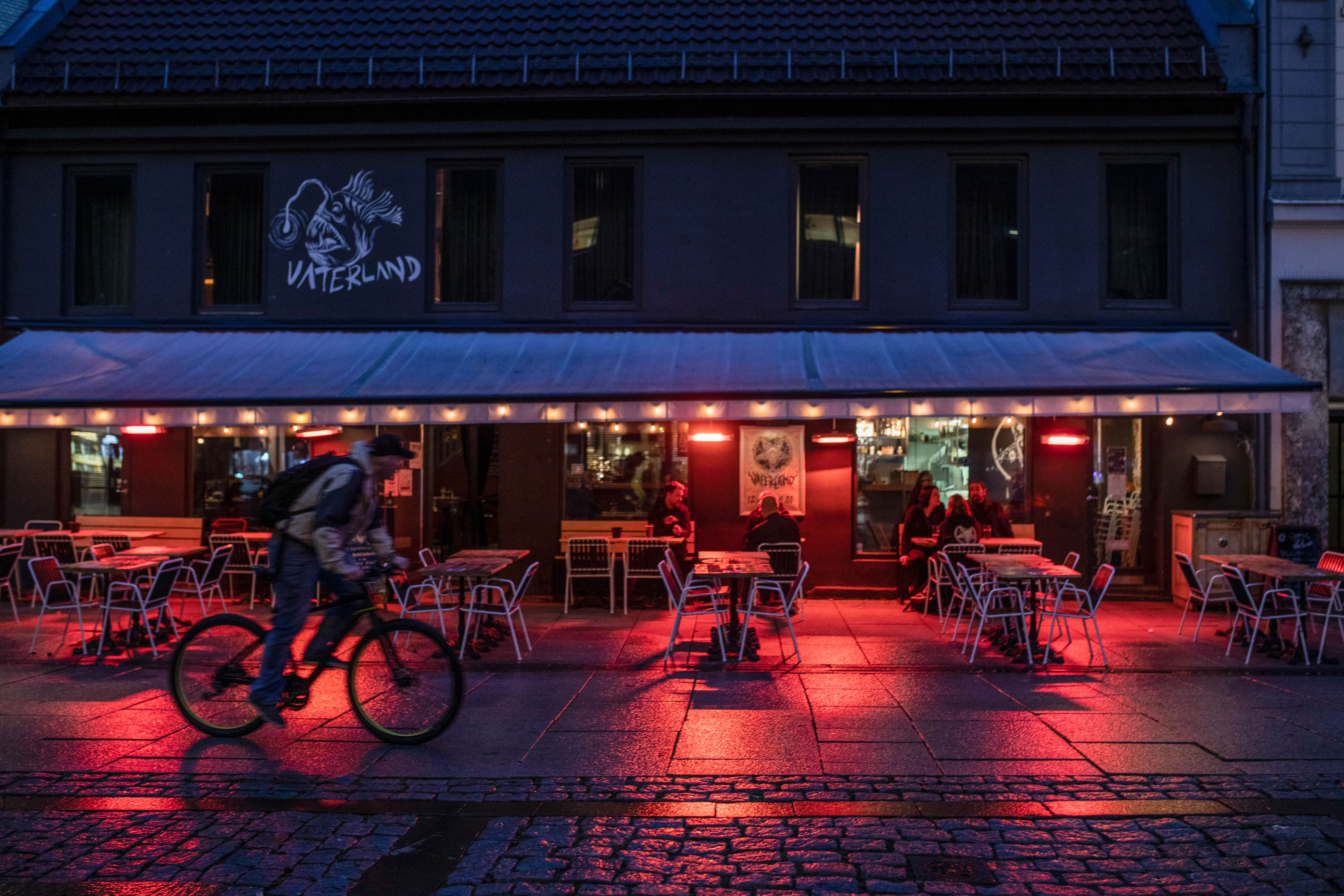 A cyclist passes a bar in Oslo, Norway, on September 23.